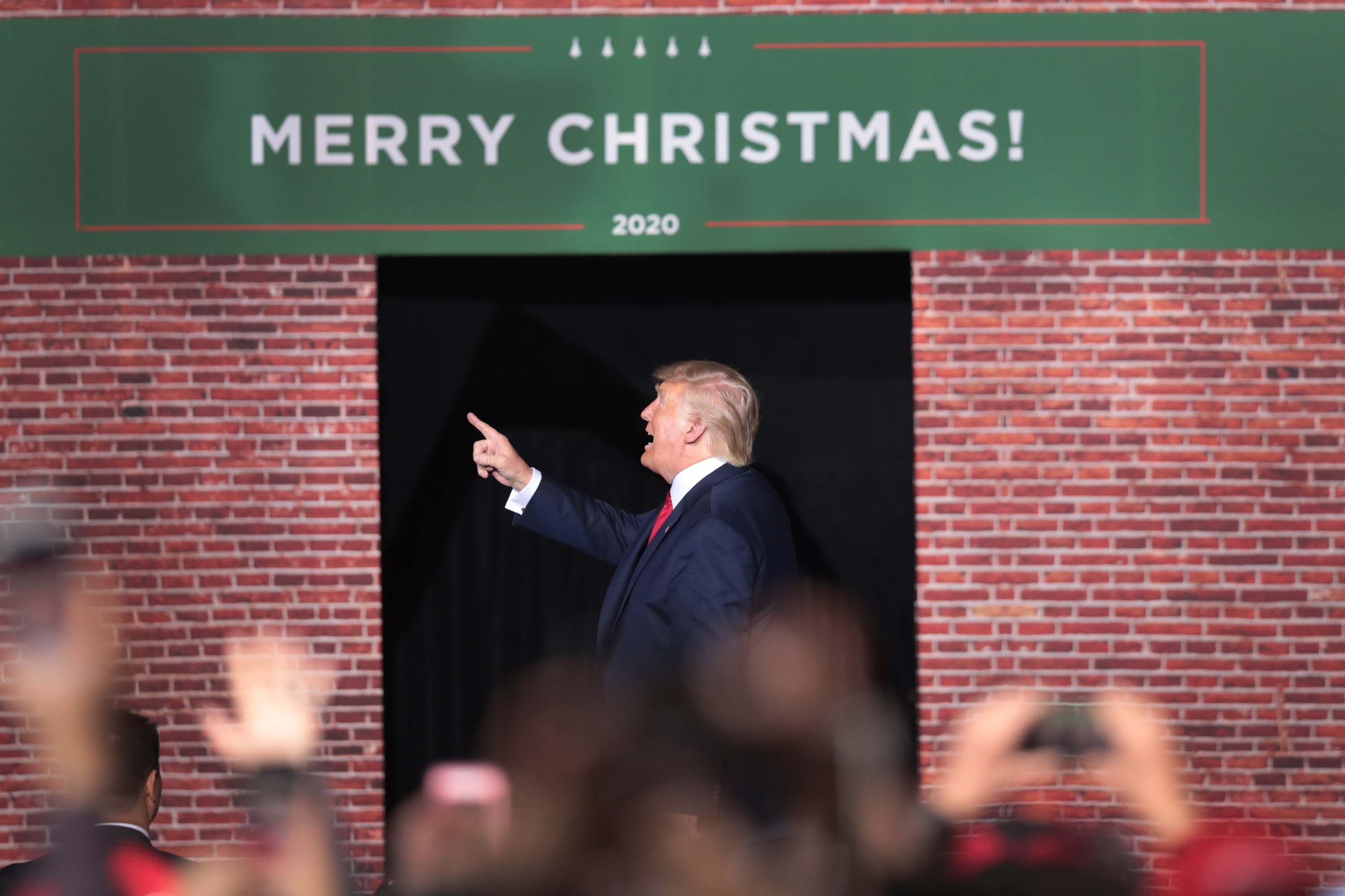 President Donald Trump leaves his Merry Christmas Rally at the Kellogg Arena on December 18, 2019 in Battle Creek, Michigan. (Scott Olson/Getty Images)