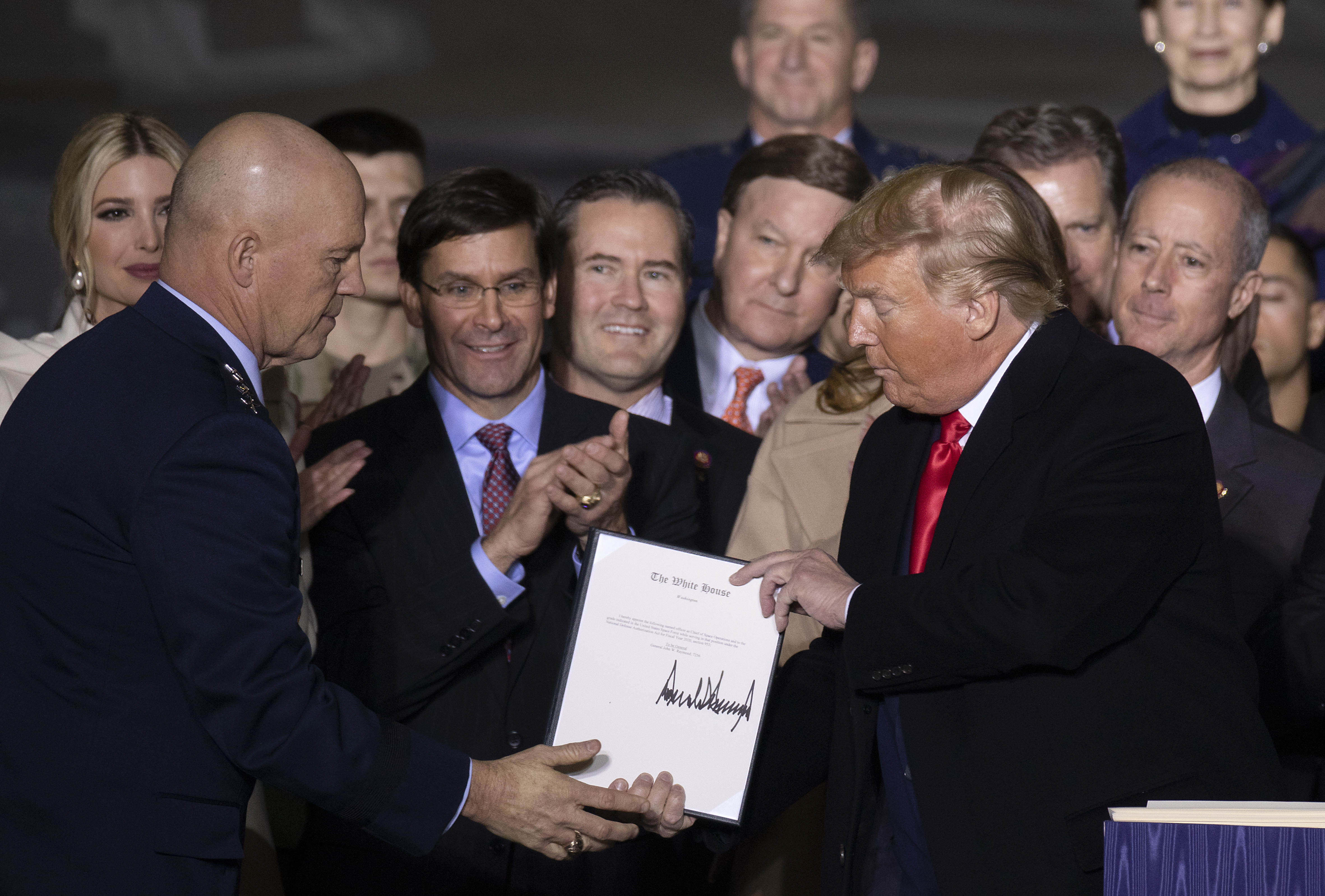Operations Chef John Raymond and US President Donald Trump at the signing ceremony for S.1709, The National Defense Authorization Act for Fiscal Year 2020 on December 20, 2019 in Joint Base Andrews, Maryland. (Tasos Katopodis/Getty Images)