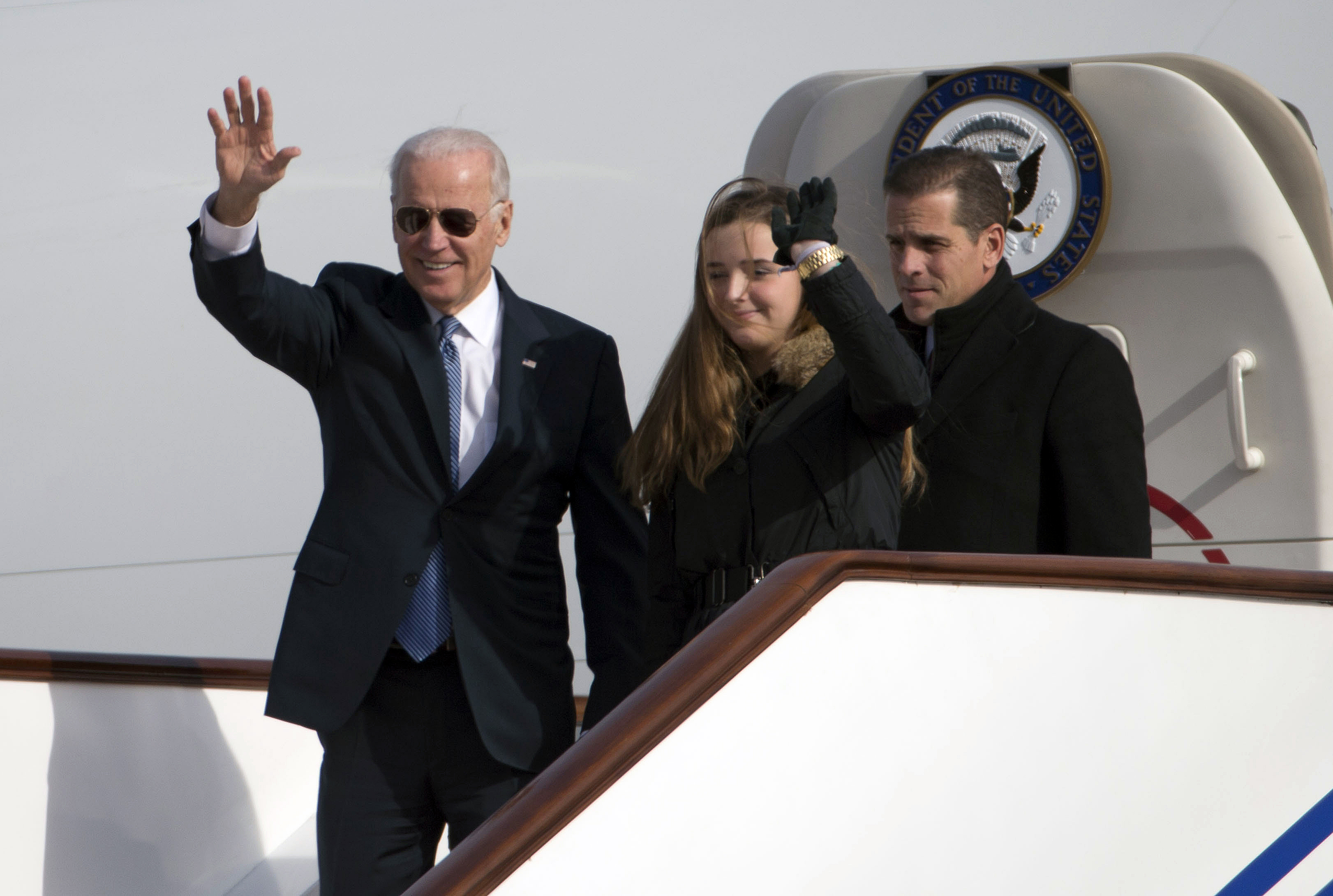 US Vice President Joe Biden waves as he walks out of Air Force Two with his granddaughter, Finnegan Biden (C) and son Hunter Biden (R) upon their arrival in Beijing on December 4, 2013. Biden arrived in Beijing on Decmber 4 amid rising friction over a Chinese air zone, needing to tread between bolstering ties with the rising power and underscoring alliances with Tokyo and Seoul (NG HAN GUAN/AFP via Getty Images)