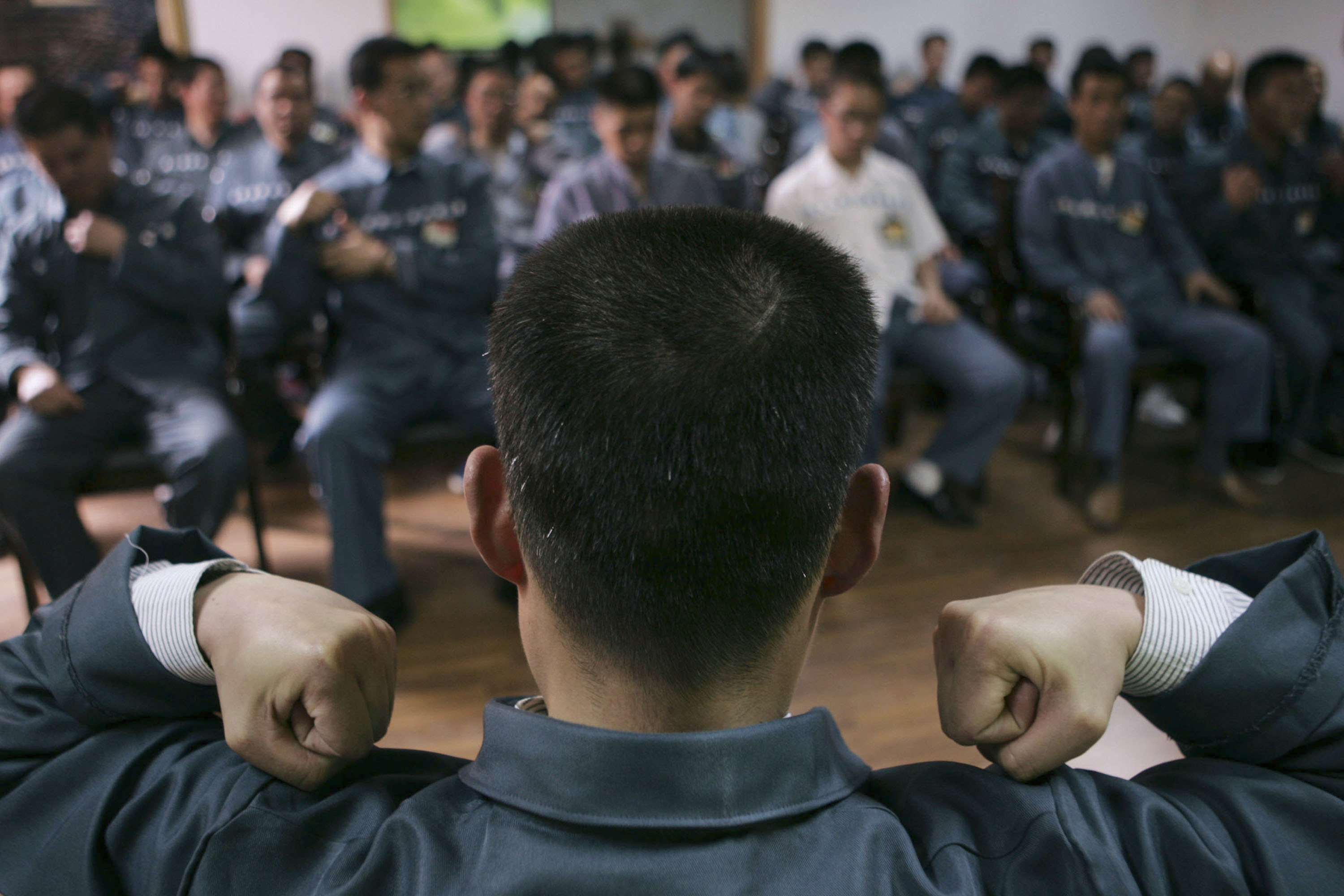 SHANGHAI, CHINA - APRIL 8: (CHINA OUT) Inmates receive a psychological correctional treatment during a psychological training and consultation session at Qingpu Prison on April 8, 2005 in Shanghai, China. China has carried out prison reform in big cities like Shanghai, Chongqing and Wuhan, with measures to better protect the legitimate rights and interests of prison inmates. Educational schemes, psychotherapy and community correctional methods are adopted in the administration of prisons. (Photo by China Photos/Getty Images)
