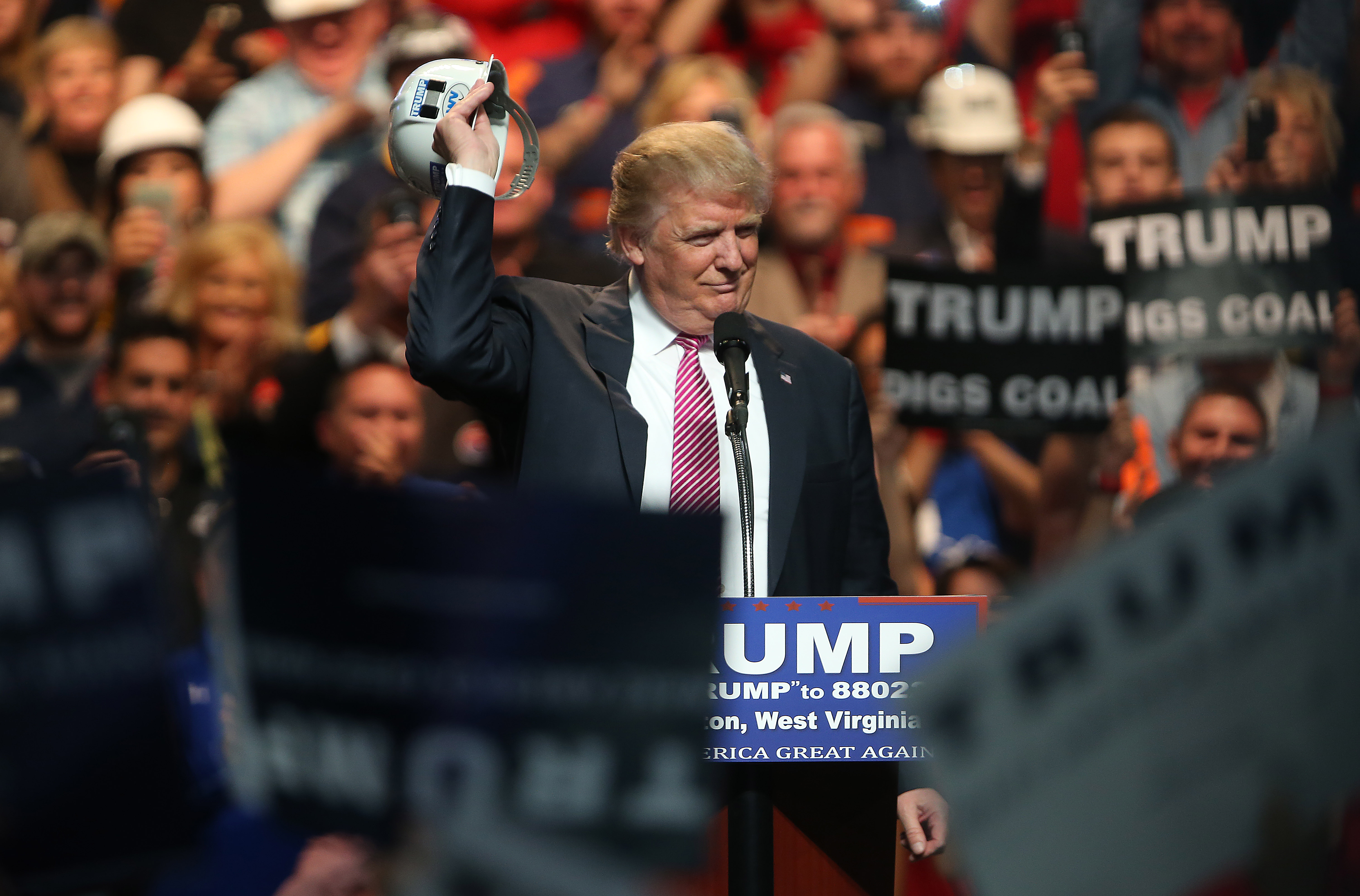 CHARLESTON, WV - MAY 05: Republican Presidential candidate Donald Trump shos off a hard hat during hie rally at the Charleston Civic Center on May 5, 2016 in Charleston, West Virginia. Trump became the Republican presumptive nominee following his landslide win in indiana on Tuesday.(Photo by Mark Lyons/Getty Images)