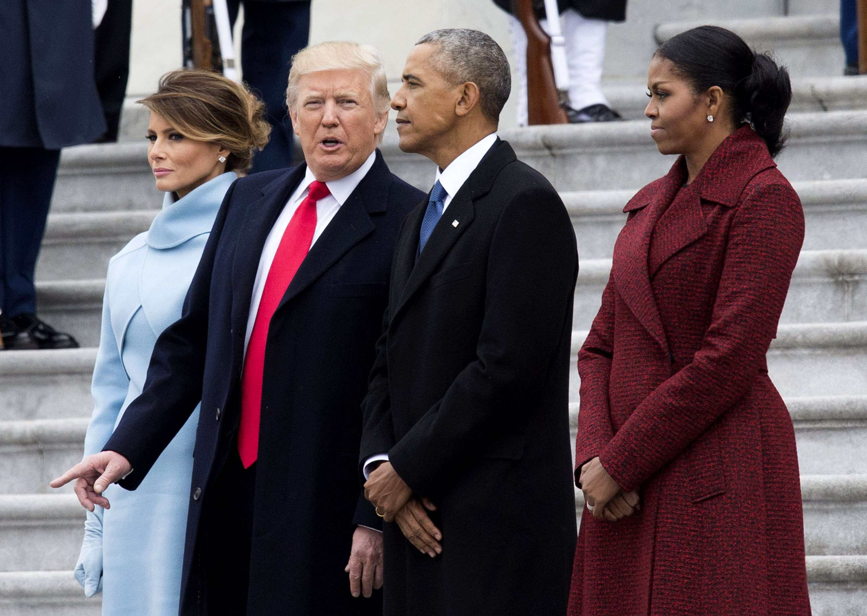 President Donald Trump (2nd-L) First Lady Melania Trump (L), former President Barack Obama (2nd-R) and former First Lady Michelle Obama walk together following the inauguration, on Capitol Hill in Washington, D.C. on January 20, 2017. (Kevin Dietsch - Pool/Getty Images)