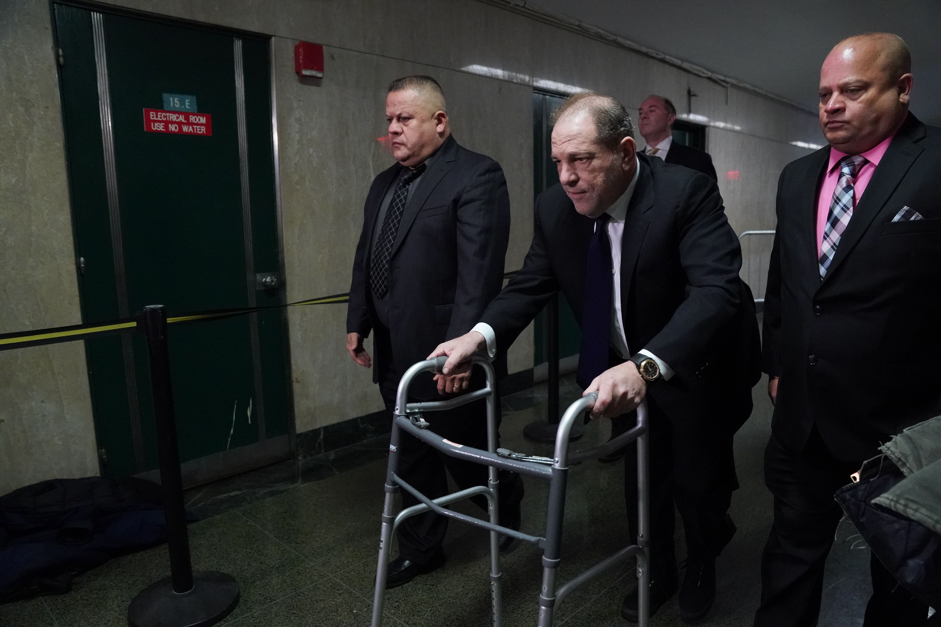 Harvey Weinstein leaves Manhattan Criminal Court using a walker, following a hearing on December 11, 2019 in New York. - The once-powerful film producer, whose case sparked the #MeToo movement against sexual harassment, appeared for a hearing, as his trial looms on January 6, 2010. The 67-year-old, who faces charges of rape and forcibly performing oral sex on a woman, has had his passport confiscated and wears an electronic tracking bracelet. (Photo by BRYAN R. SMITH/AFP via Getty Images)