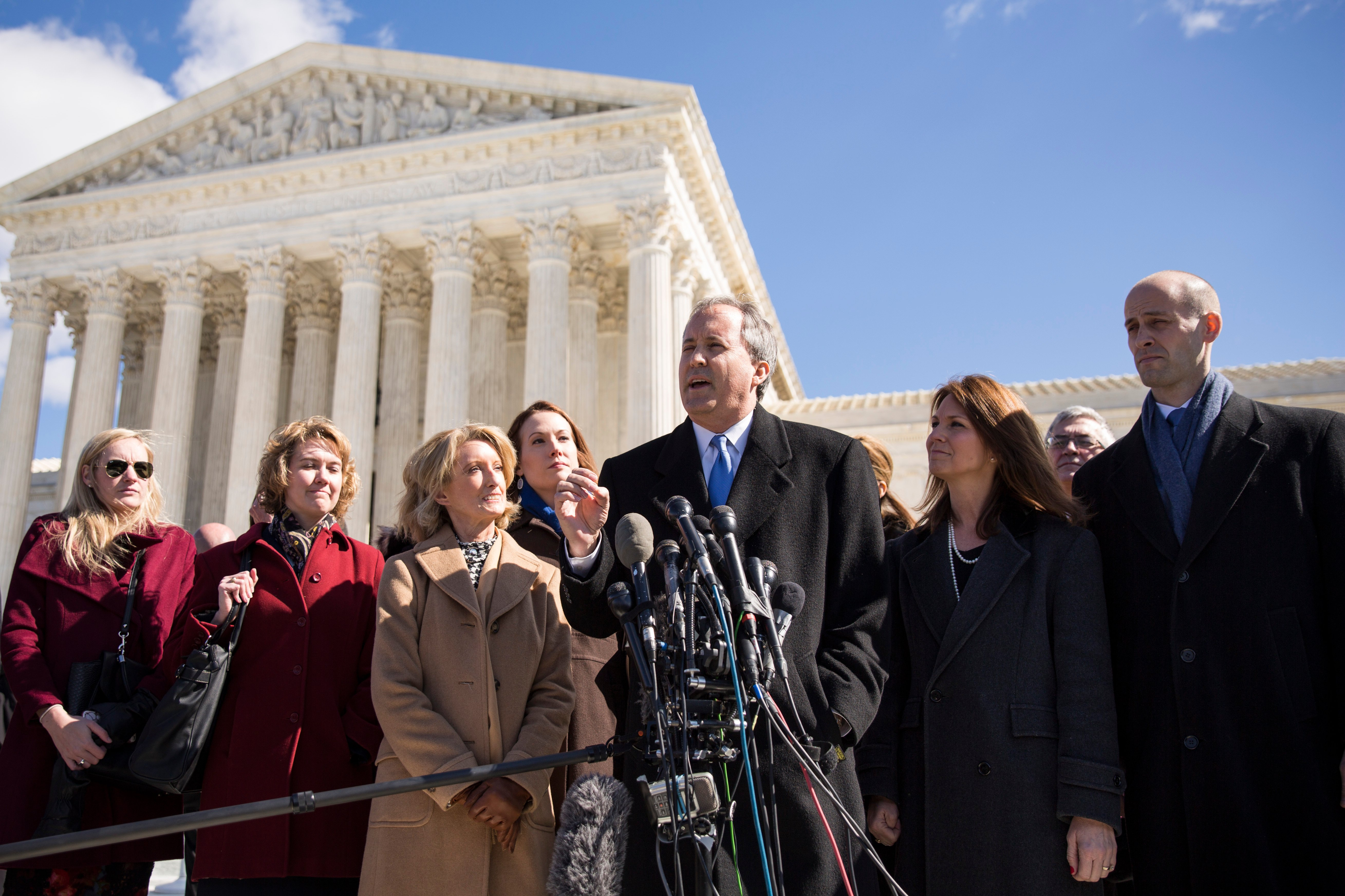 Texas Attorney General Ken Paxton speaks in front of the Supreme Court on March 2, 2016. (Drew Angerer/Getty Images)