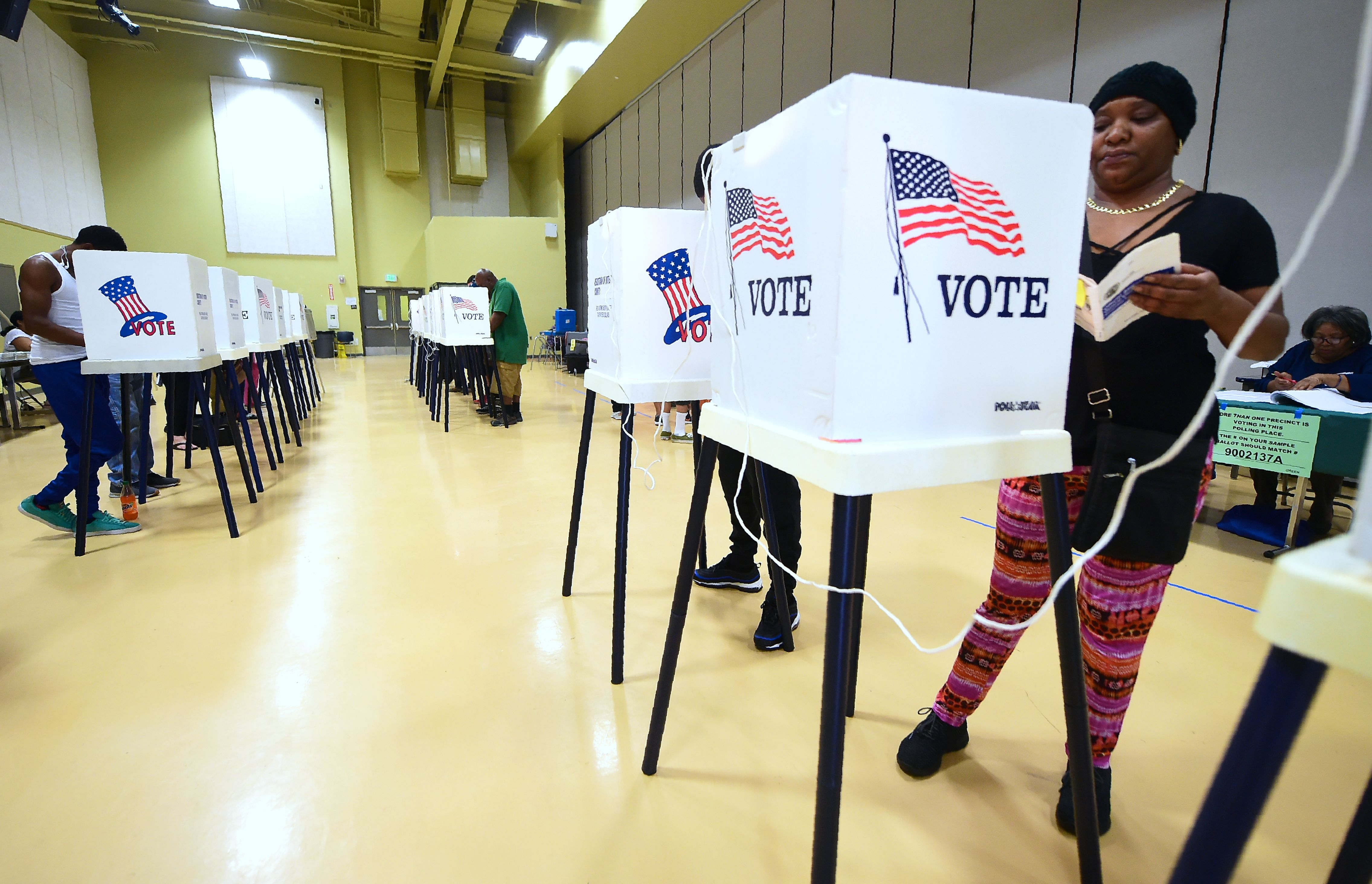 People vote from booths inside the gymnasium at the Barack Obama Prep Academy on November 6, 2018 in Los Angeles, California. - Americans started voting Tuesday in critical midterm elections that mark the first major voter test of Donald Trump's controversial presidency, with control of Congress at stake. About three quarters of the 50 states in the east and center of the country were already voting as polls began opening at 6:00 am (1100 GMT) for the day-long ballot. (FREDERIC J. BROWN/AFP via Getty Images)