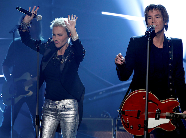 """Marie Fredriksson (L) and Per Gessle of Swedish pop duo Roxette perform during the German game show """"Wetten Dass"""" (Bet it...?) in Halle, Germany, February 13, 2011. Fredriksson died on Monday at the age of 61 after having spent years battling cancer and the lingering effects of its treatment, her manager said./File Photo-Reuters"""