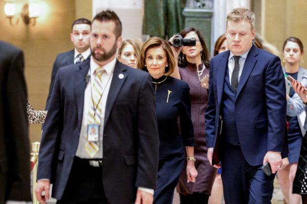 House Speaker Nancy Pelosi (D-CA) walks through Statuary Hall prior to votes in the U.S. House of Representatives on two articles of impeachment against U.S. President Donald Trump on Capitol Hill in Washington, U.S., December 18, 2019. (REUTERS/Tom Brenner)