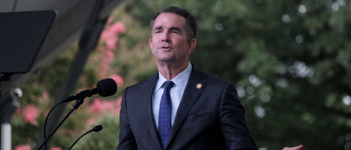 Virginia's Governor Ralph Northam delivers a speech at the 2019 African Landing Commemorative Ceremony, observing the 400 year anniversary of the arrival of the first enslaved Africans in Virginia, in Hampton, Virginia, U.S., August 24, 2019. [REUTERS/Michael A. McCoy]