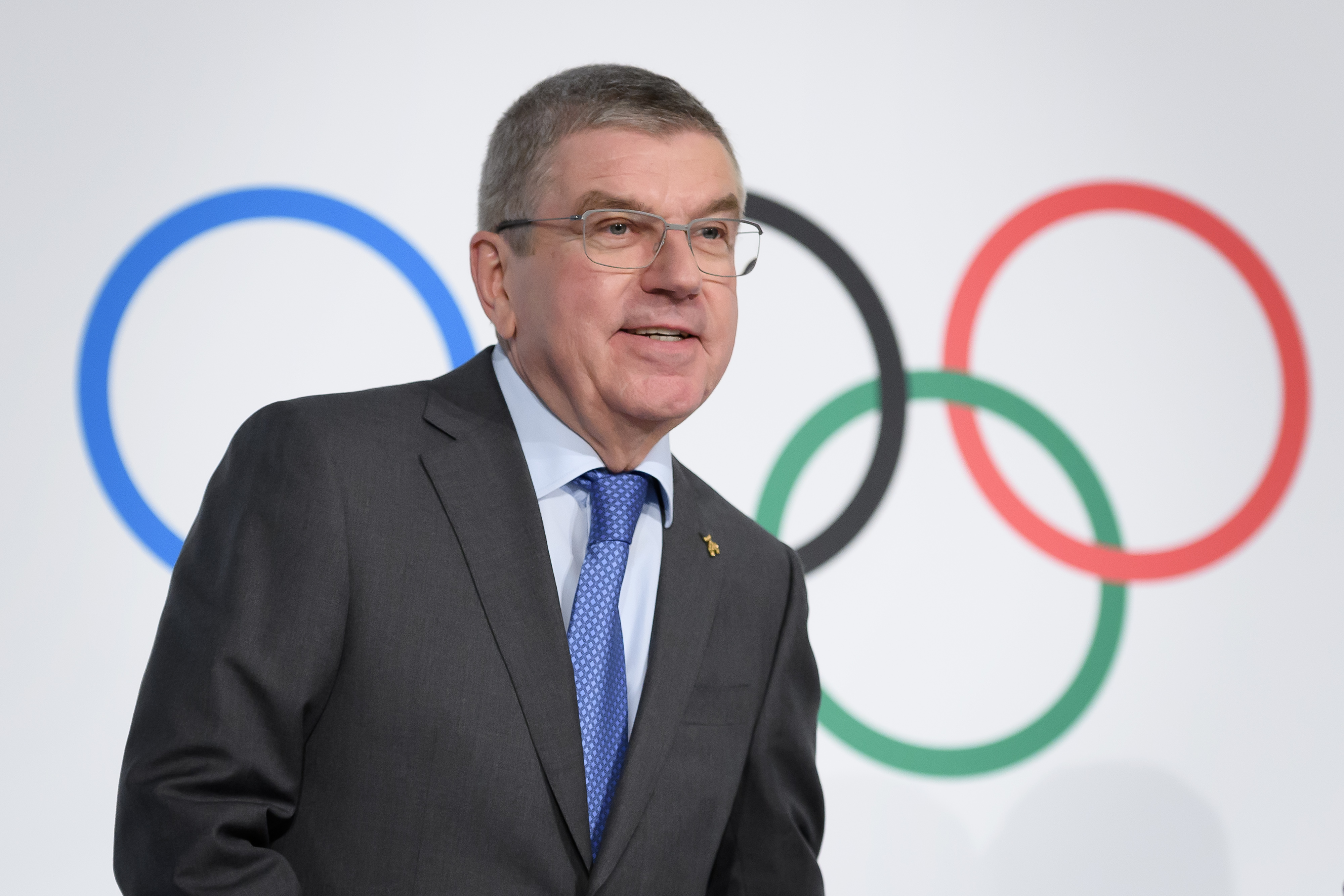 International Olympic Committee (IOC) president Thomas Bach arrives to a press conference following an executive board meeting at the IOC headquarters in Lausanne, on December 5, 2019. - The Russian case will dominate the IOC Executive Board meeting a few days before the decision of the World Anti-Doping Agency (WADA) expected on December 9, following a recommendation by an independent WADA committee paving the way for Russia to be suspended from the next Olympic Games. (Photo by FABRICE COFFRINI/AFP via Getty Images)