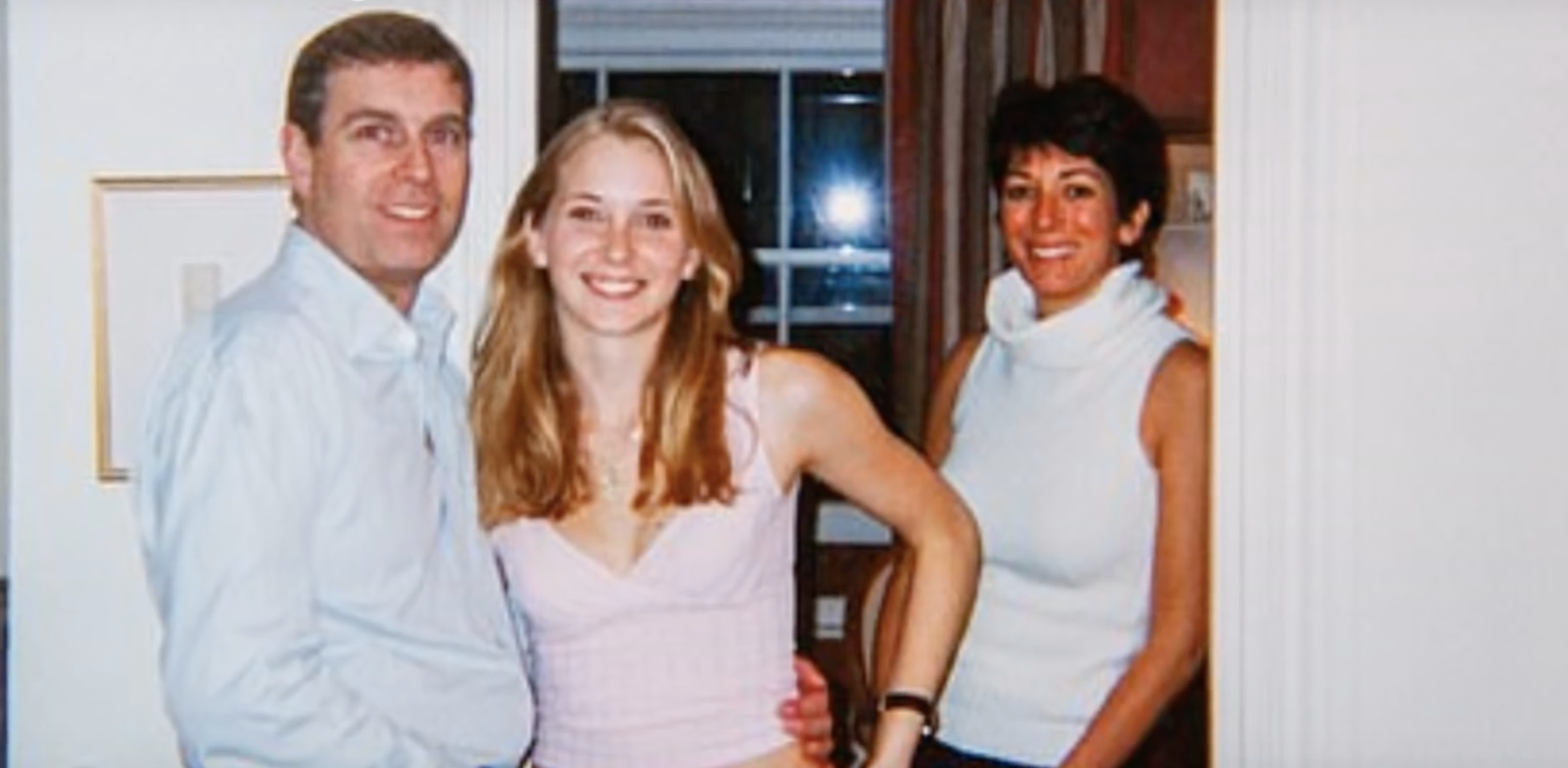 Prince Andrew (left) is seen with Virginia Roberts Giuffre (center) and Ghislaine Maxwell (right) in a photograph that the Duke of York has suggested could be fake. (Screenshot Youtube The Telegraph)