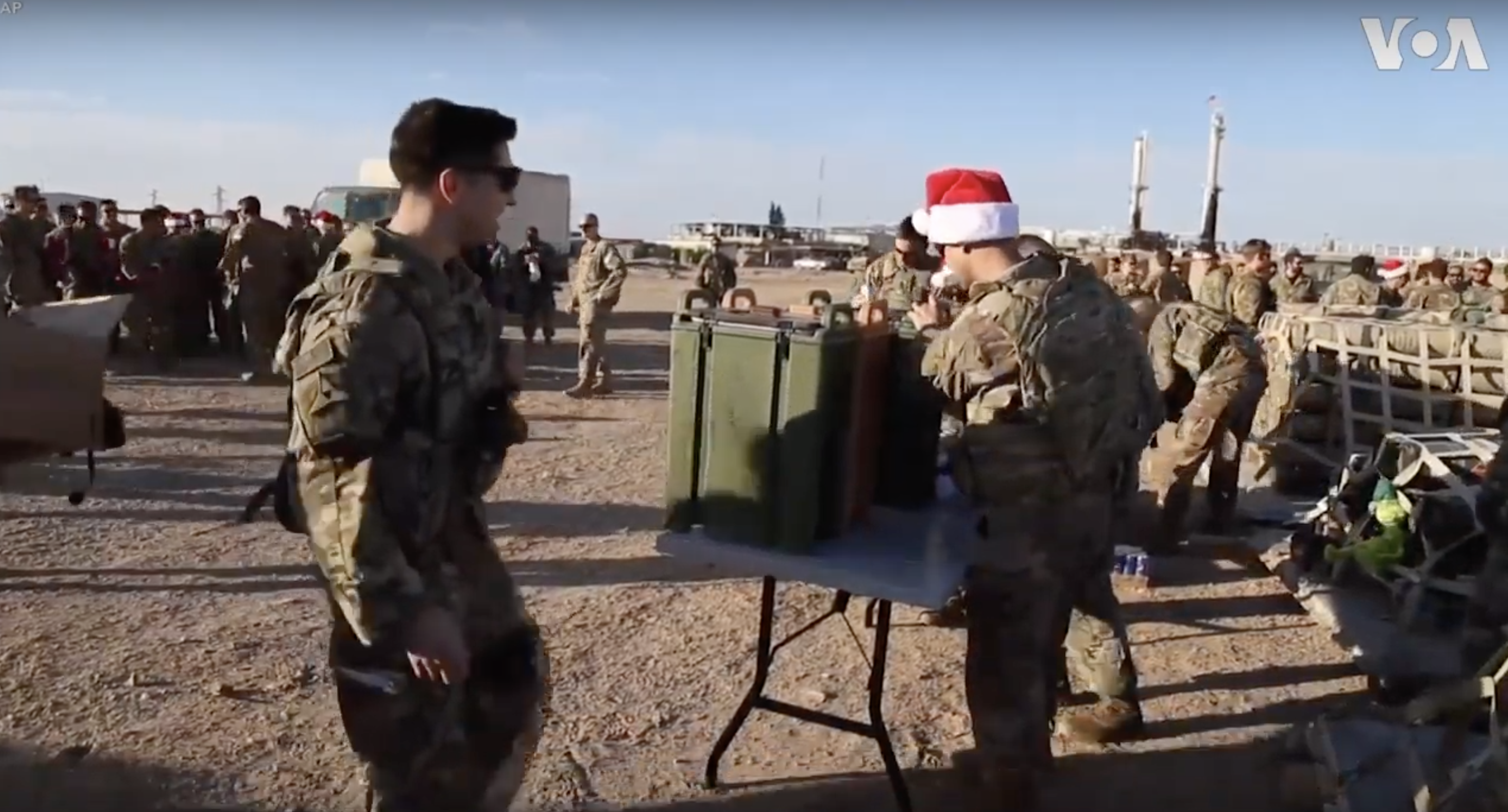Christmas presents were delivered to American troops serving in Syria. (YouTube/Screenshot/Public — User: VOA)