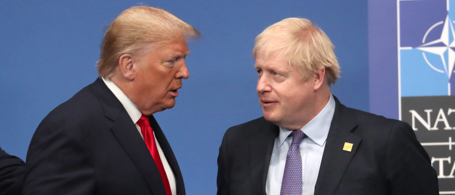 HERTFORD, ENGLAND - DECEMBER 04: US President Donald Trump and British Prime Minister Boris Johnson onstage during the annual NATO heads of government summit on December 4, 2019 in Watford, England. France and the UK signed the Treaty of Dunkirk in 1947 in the aftermath of WW2 cementing a mutual alliance in the event of an attack by Germany or the Soviet Union. The Benelux countries joined the Treaty and in April 1949 expanded further to include North America and Canada followed by Portugal, Italy, Norway, Denmark and Iceland. This new military alliance became the North Atlantic Treaty Organisation (NATO). The organisation grew with Greece and Turkey becoming members and a re-armed West Germany was permitted in 1955. This encouraged the creation of the Soviet-led Warsaw Pact delineating the two sides of the Cold War. This year marks the 70th anniversary of NATO. (Photo by Steve Parsons-WPA Pool/Getty Images)
