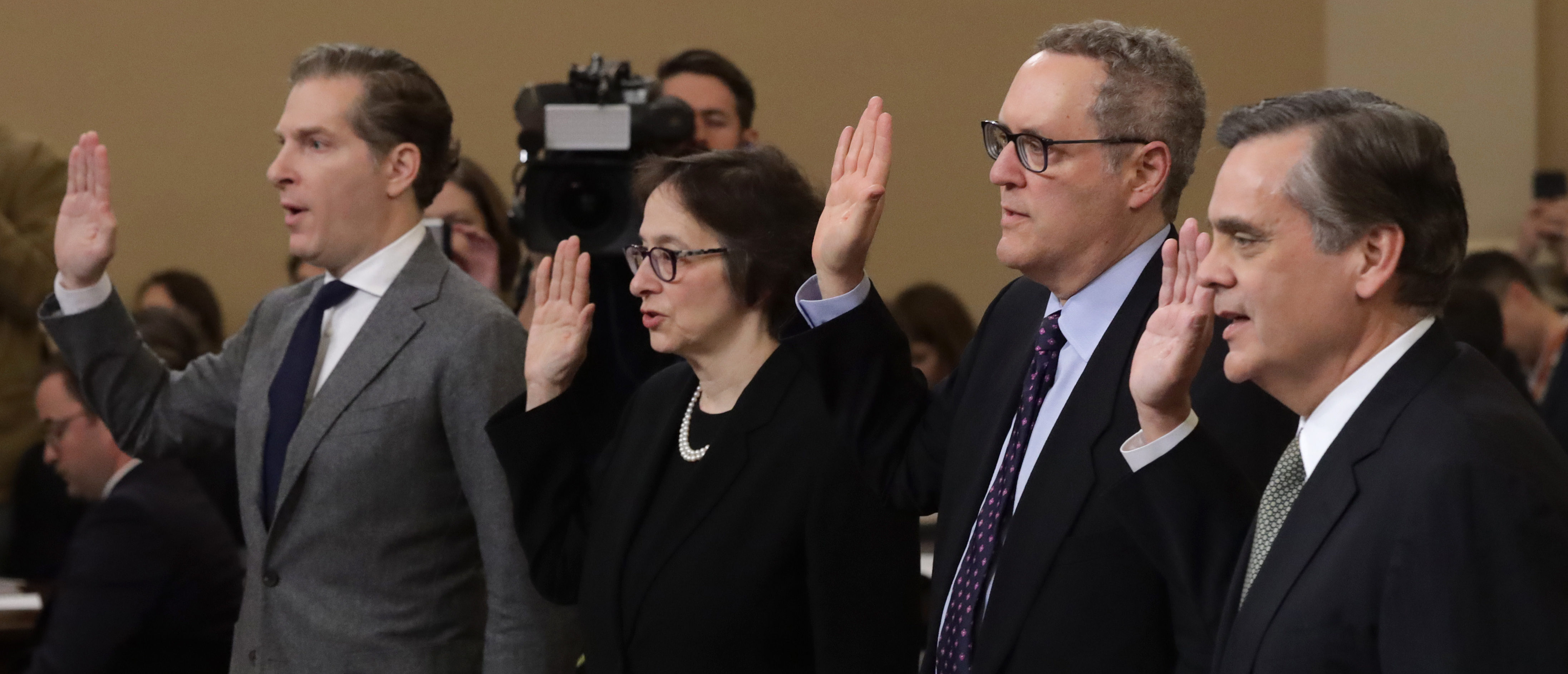 Constitutional scholars (L-R) Noah Feldman of Harvard University, Pamela Karlan of Stanford University, Michael Gerhardt of the University of North Carolina, and Jonathan Turley of George Washington University are sworn in prior to testifying before the House Judiciary Committee in the Longworth House Office Building on Capitol Hill December 4, 2019 in Washington, DC. This is the first hearing held by the House Judiciary Committee in the impeachment inquiry against U.S. President Donald Trump, whom House Democrats say held back military aid for Ukraine while demanding it investigate his political rivals. The Judiciary Committee will decide whether to draft official articles of impeachment against President Trump to be voted on by the full House of Representatives. (Photo by Alex Wong/Getty Images)