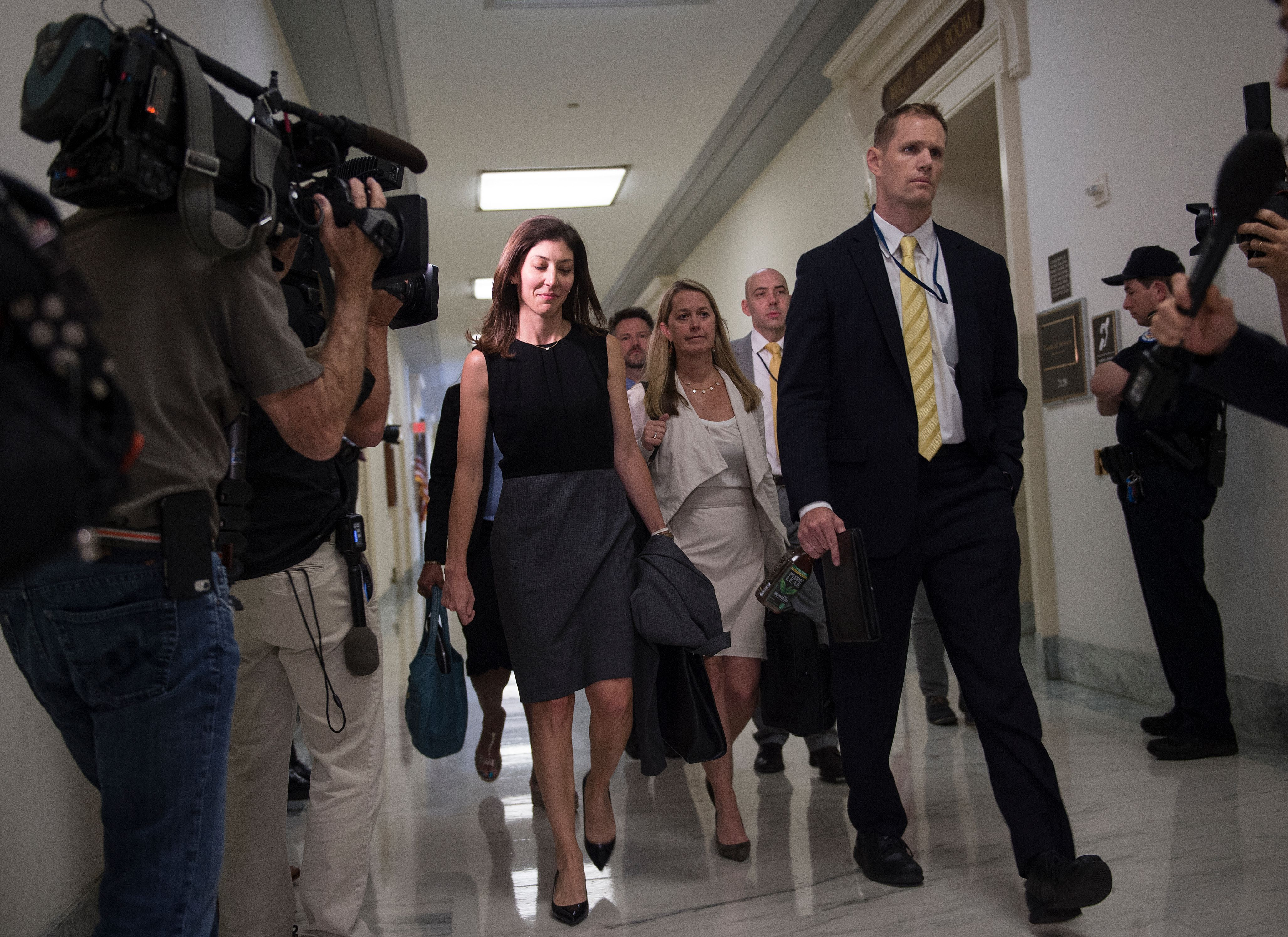 "Lisa Page, former legal counsel to former FBI Director Andrew Mc Cabe, arrives on Capitol Hill July 13, 2018 to provide closed-door testimony about the texts critical of Donald Trump that she exchanged with her FBI agent lover during the 2016 presidential campaign. - Republicans accuse the pair, Lisa Page and Peter Strzok, of deep anti-Trump bias as they helped conduct investigations of both Hillary Clinton and the candidate who would eventually become the US president. Page -- whose affair with Strzok has led Trump to dub them the ""FBI lovers"" -- struck a deal with the House Judiciary Committee to testify privately after months of attempts to haul her before Congress, including defying a subpoena to testify publicly this week. (Photo by ANDREW CABALLERO-REYNOLDS / AFP via Getty Images)"