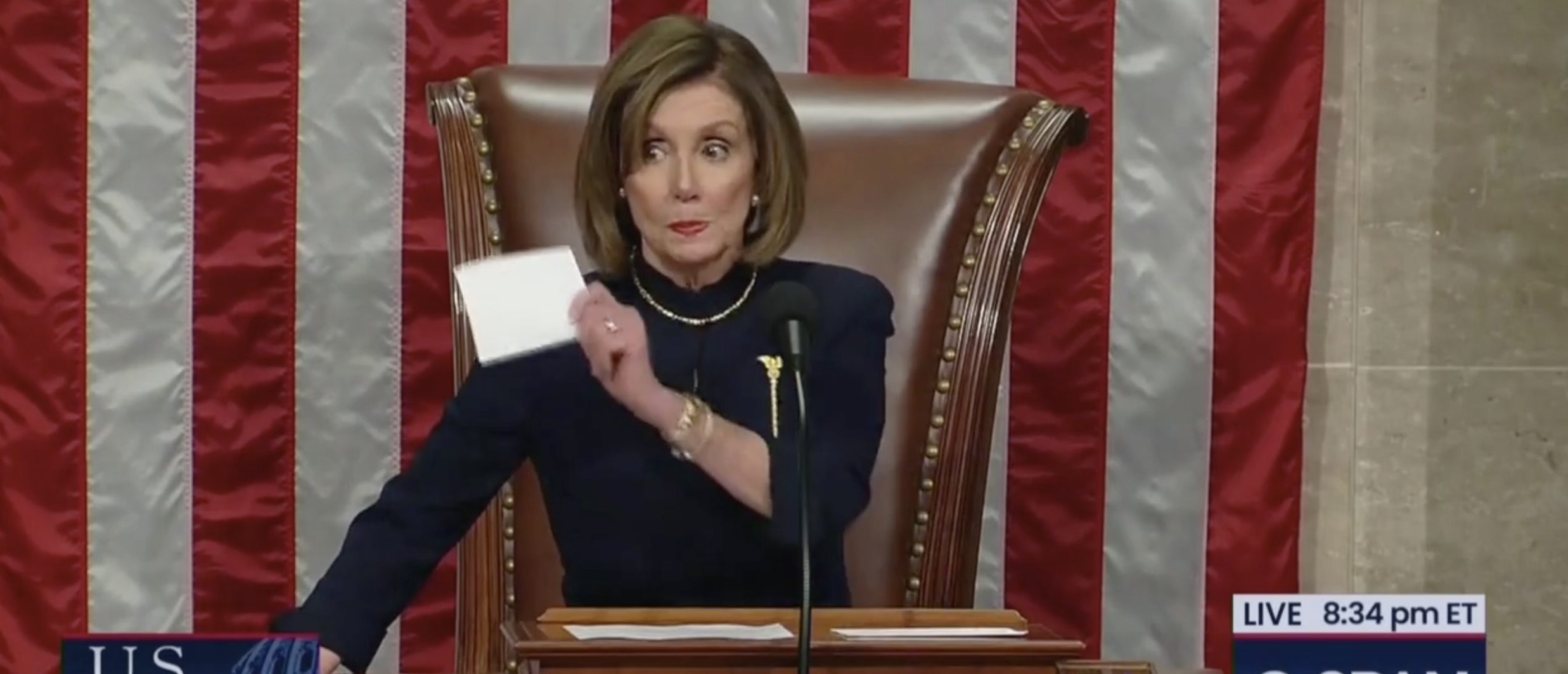 House Speaker Nancy Pelosi shot a withering glare at Democrats who applauded when she announced that the first article of impeachment against President Donald Trump had passed Wednesday. Screenshot/CSPAN