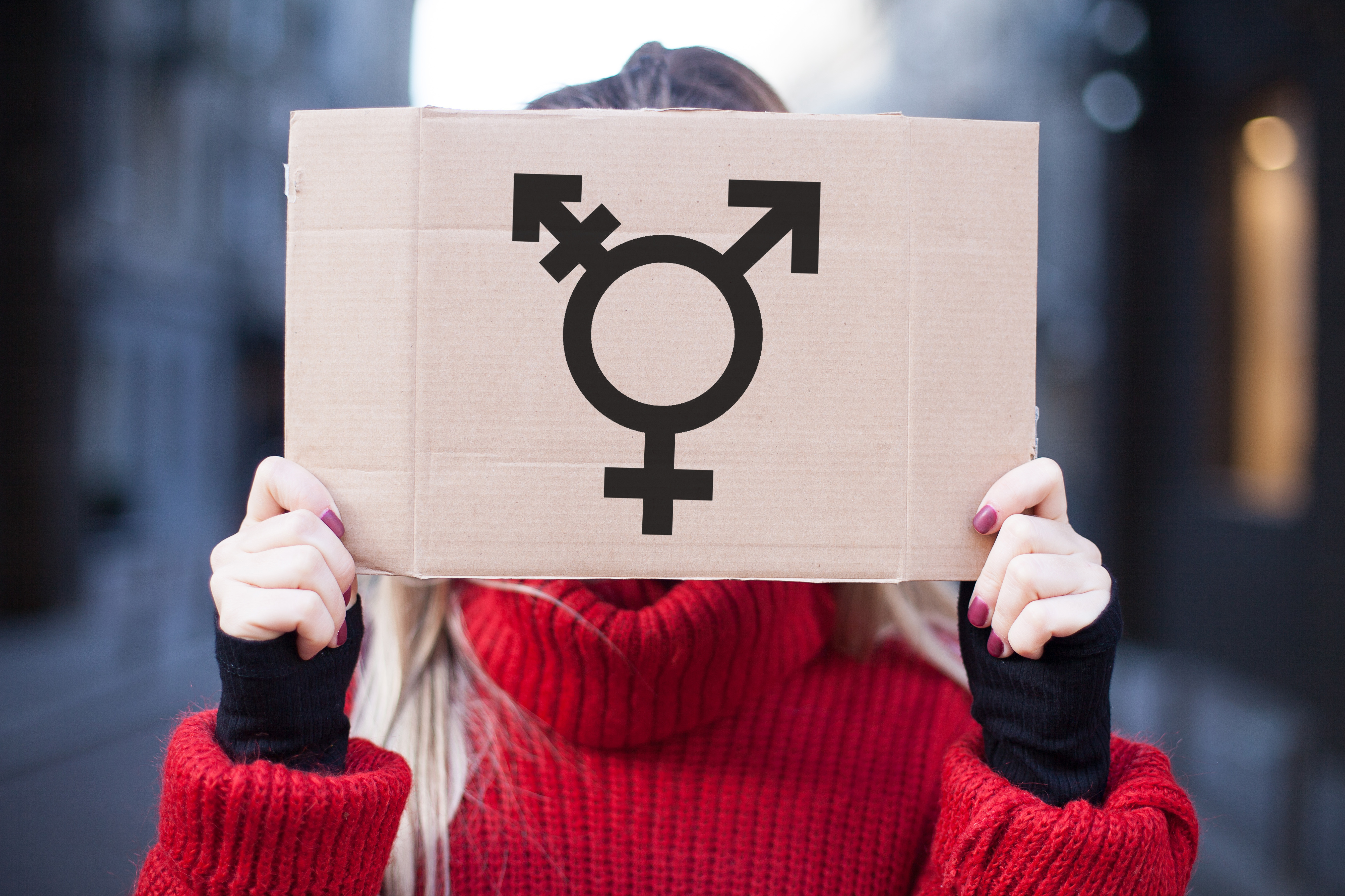 The symbol of the transgender in hands on a cardboard plate, covering (hiding) the face. - Image (Shutterstock/AndrilZatsrozhnov)