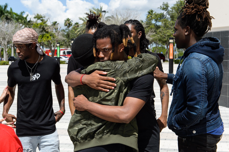 JUNE 27: Denzel Curry hugs a friend outside the XXXTentacion Funeral & Fan Memorialat BB&T Center on June 27, 2018 in Sunrise, Florida. (Photo by Jason Koerner/Getty Images)