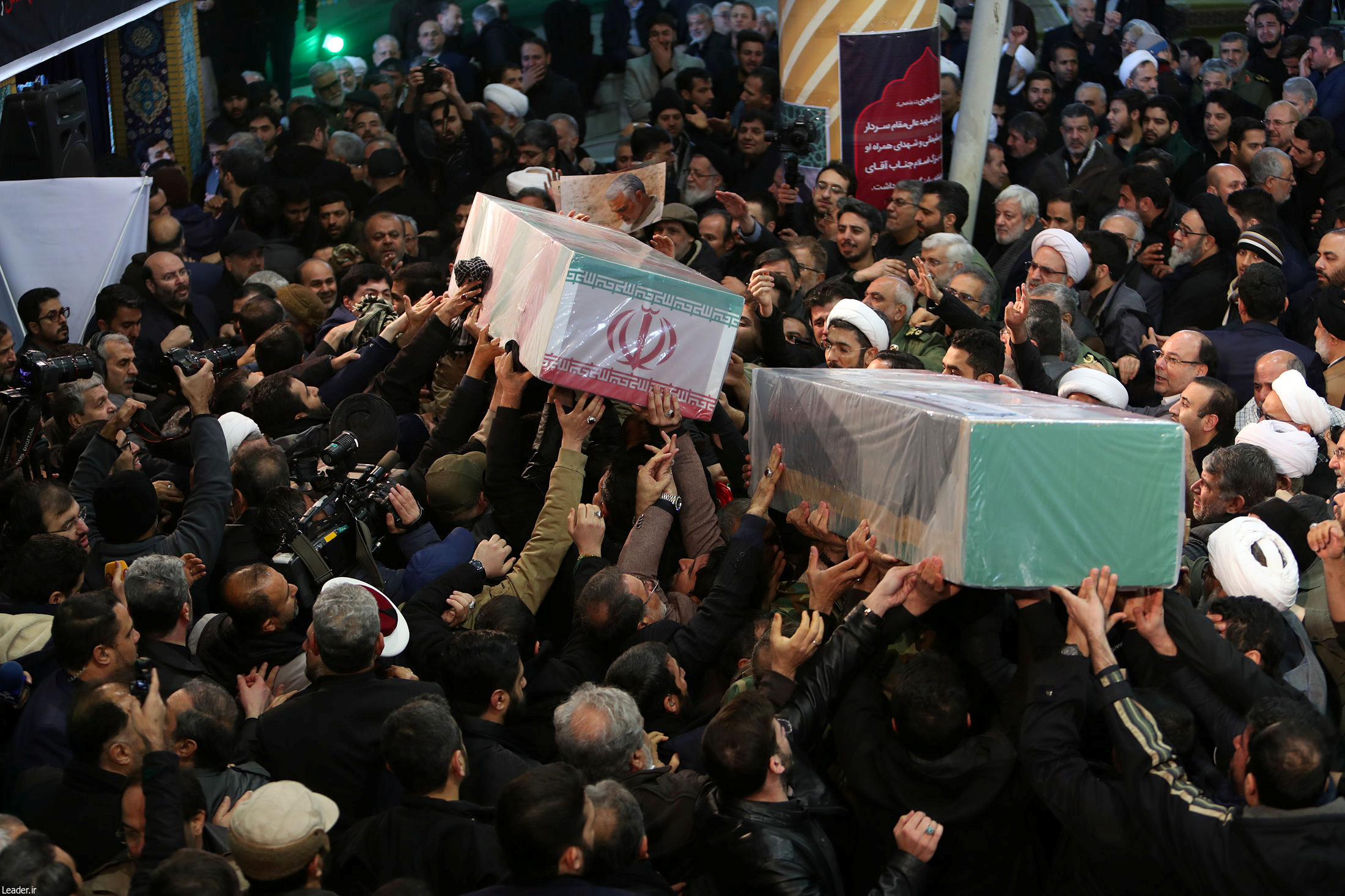 Iranian people attend a funeral for Iranian Major-General Qassem Soleimani, head of the elite Quds Force, and Iraqi militia commander Abu Mahdi al-Muhandis, who were killed in an air strike at Baghdad airport, in Tehran, Iran Jan. 6, 2020. Official Khamenei website/Handout via REUTERS