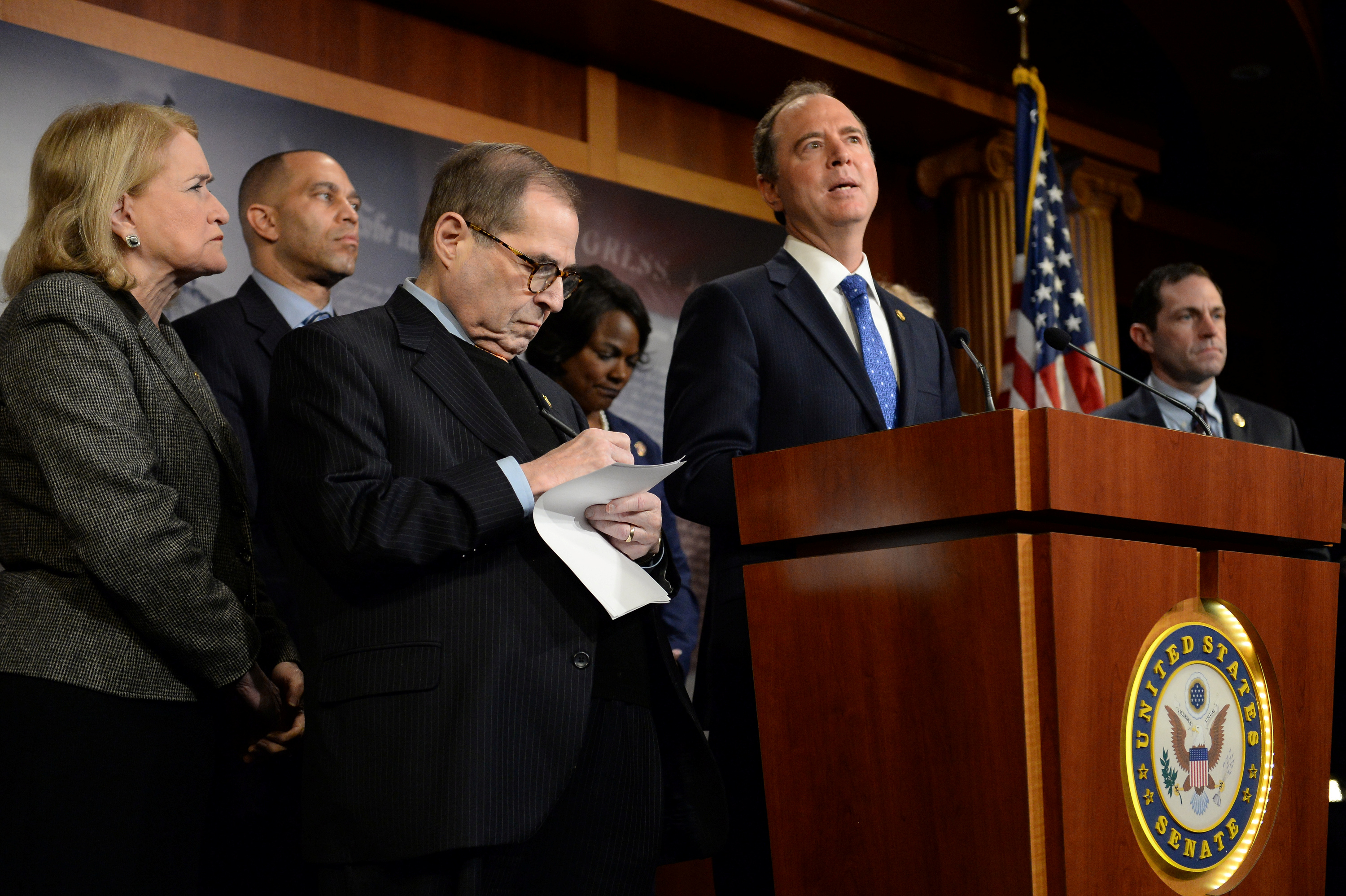 Rep. Adam Schiff (D-CA) speaks as fellow House Impeachment Managers, Sylvia Garcia (D-TX), Hakeem Jeffries (D-NY), Jerry Nadler (D-NY), Val Demings (D-FL), Zoe Lofgren (D-CA) and Jason Crow (D-CO), listen after the impeachment trial of U.S. President Donald Trump ended for the day in Washington, U.S., Jan. 25, 2020. REUTERS/Mary F. Calvert