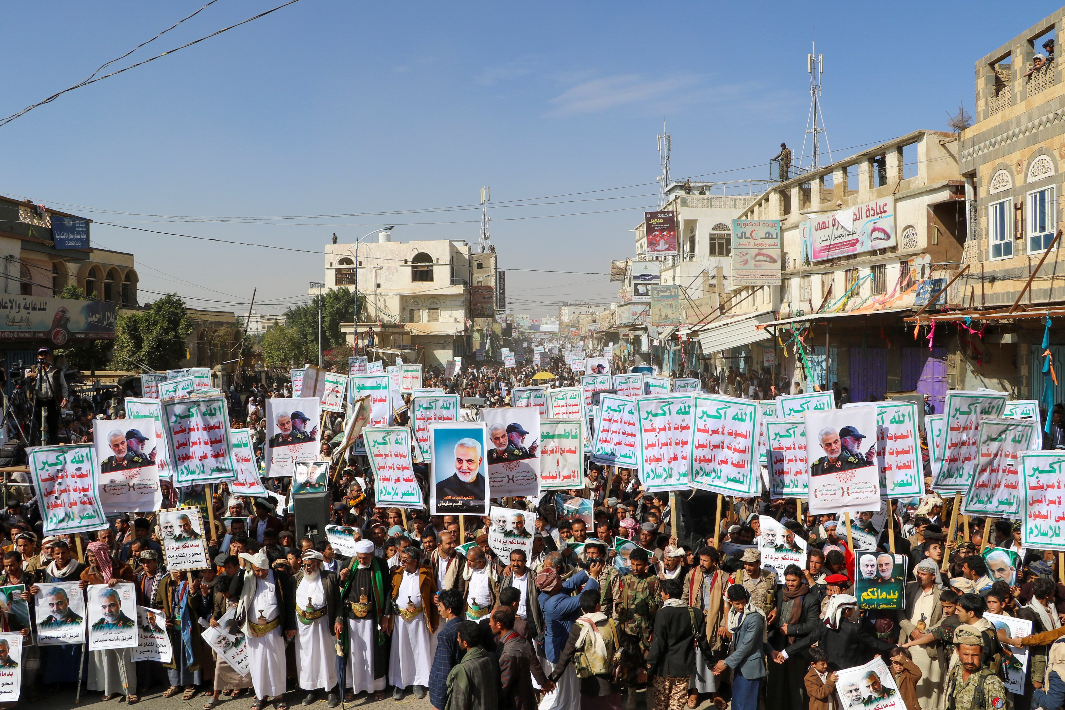 "Supporters of the Houthis rally to denounce the U.S. killing of Iranian Major-General Qassem Soleimani, head of the elite Quds Force, and Iraqi militia commander Abu Mahdi al-Mutha dis, in Saada, Yemen Jan. 6, 2020. The placards read: ""God is the Greatest, Death to America, Death to Israel, Curse on the Jews, Victory to Islam."" REUTERS/Naif Rahma"