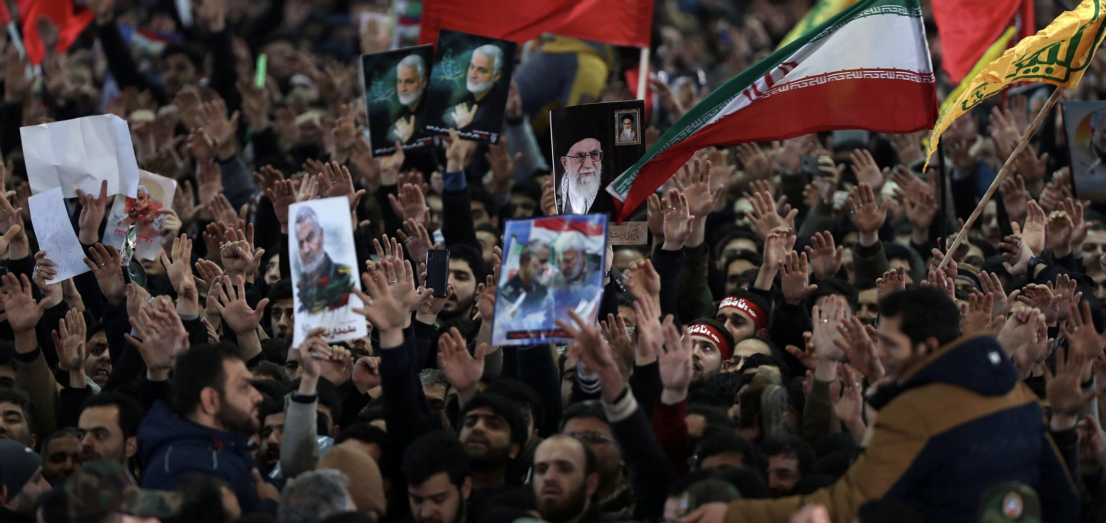 Iranian people carry pictures of Iran's Supreme Leader Ayatollah Ali Khamenei and Qassem Soleimani during a funeral for Iranian Major-General Qassem Soleimani, head of the elite Quds Force, and Iraqi militia commander Abu Mahdi al-Muhandis, who were killed in an air strike at Baghdad airport, in Tehran, Iran January 6, 2020. Official Khamenei website/Handout via REUTERS
