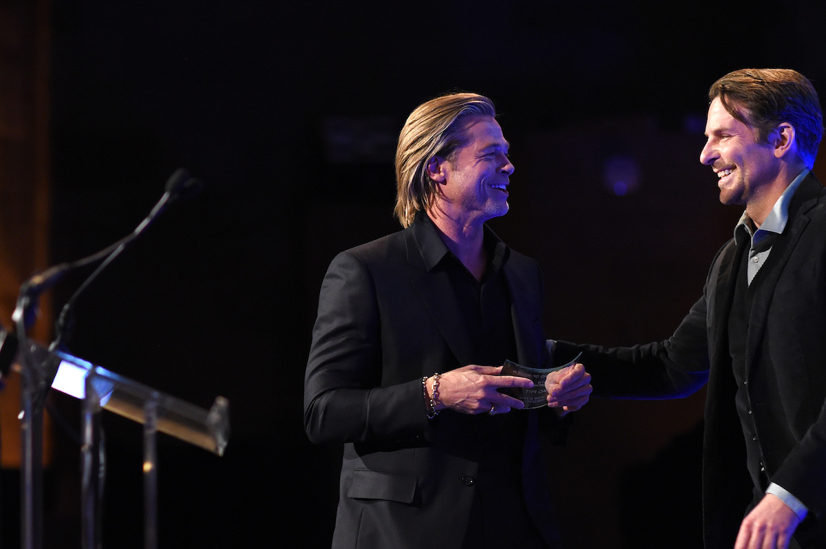 Brad Pitt accepts the award for Best Supporting Actor for Once Upon A Time... In Hollywood from Bradley Cooper onstage during The National Board of Review Annual Awards Gala at Cipriani 42nd Street on January 08, 2020 in New York City. (Photo by Jamie McCarthy/Getty Images for National Board of Review)