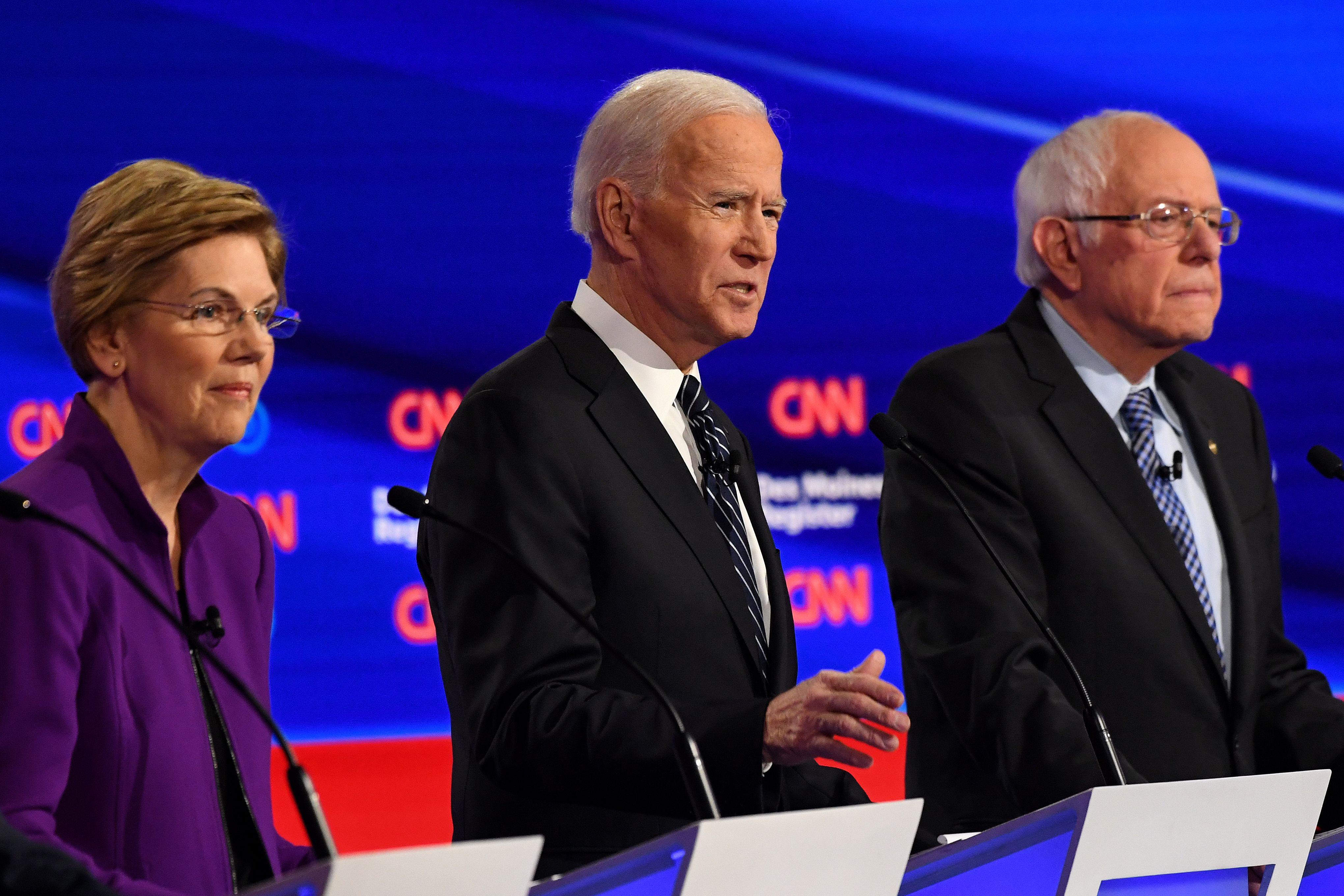 Democratic presidential hopefuls Elizabeth Warren, Joe Biden, and Bernie Sanders at the seventh Democratic primary debate on January 14, 2020. (Robyn Beck/AFP/Getty Images)