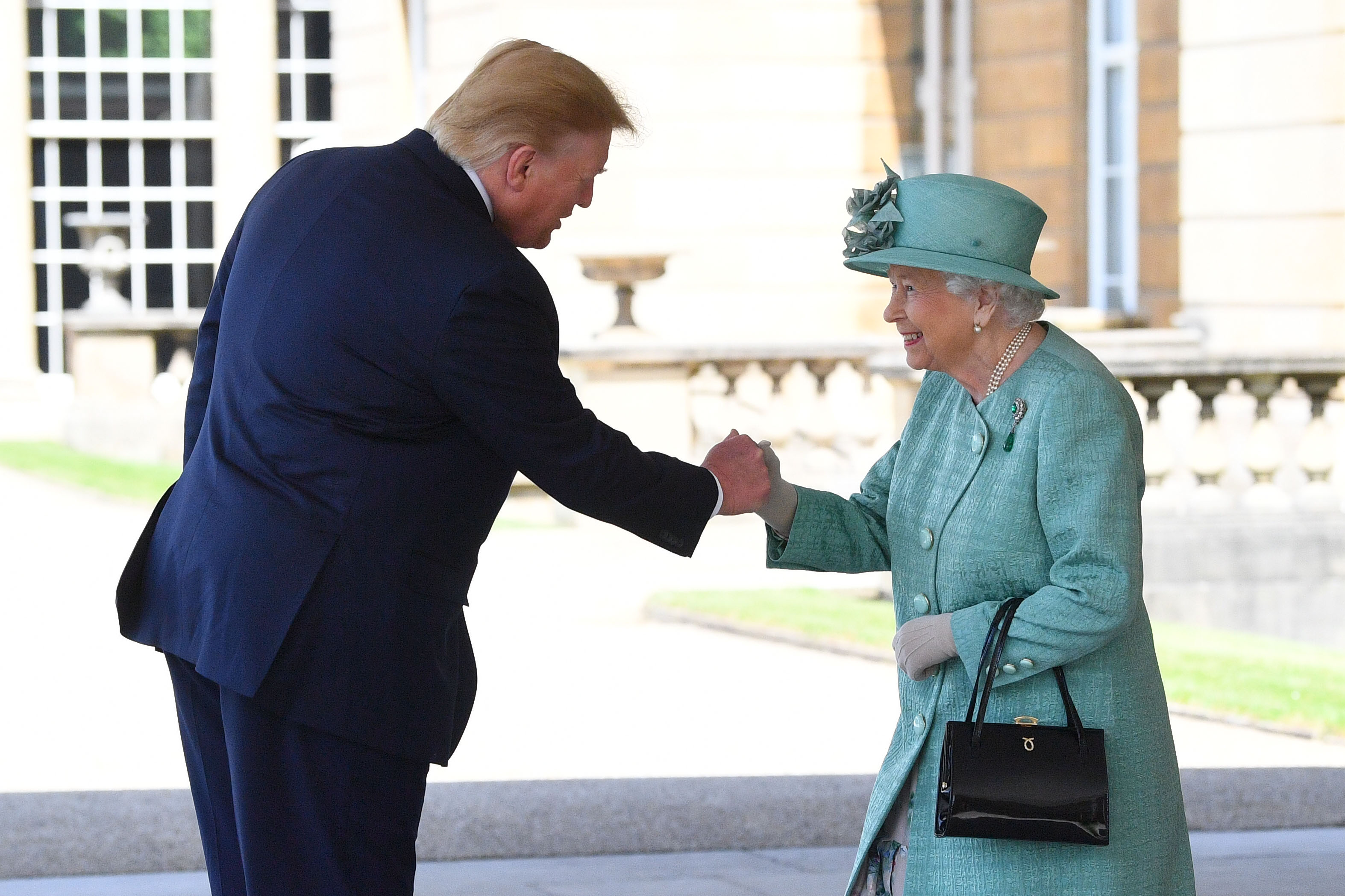 U.S. President Donald Trump is greeted by Queen Elizabeth II at Buckingham Palace on June 3, 2019 in London, England. President Trump's three-day state visit will include lunch with the Queen, and a State Banquet at Buckingham Palace, as well as business meetings with the Prime Minister and the Duke of York, before travelling to Portsmouth to mark the 75th anniversary of the D-Day landings. (Photo by Victoria Jones - WPA Pool/Getty Images)