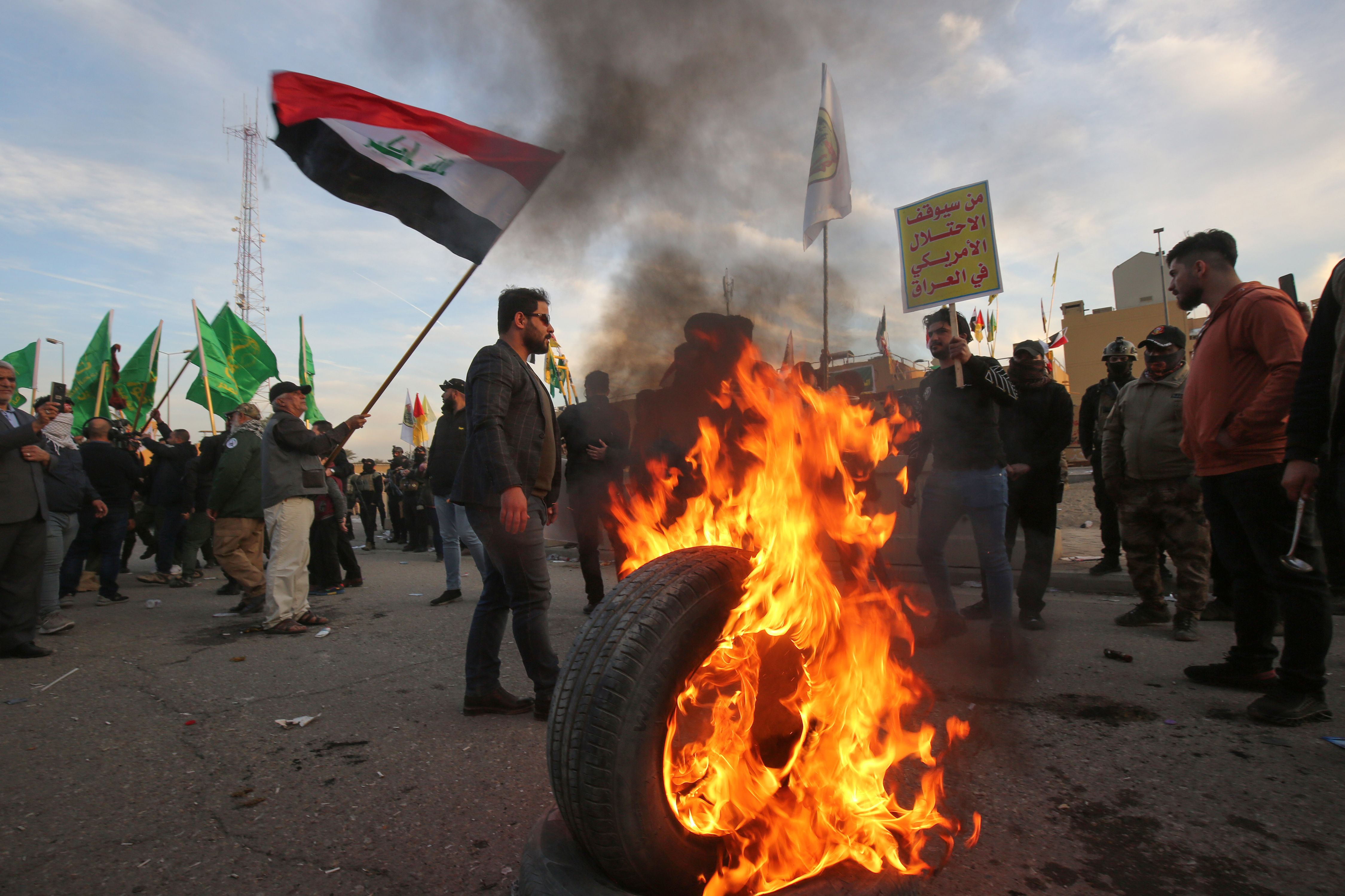 Supporters of Iraq's Hashed al-Shaabi paramilitary force protest outside the US embassy in the Iraqi capital Baghdad on January 1, 2020 to condemn the US air strikes that killed 25 Hashed fighters over the weekend. (AHMAD AL-RUBAYE/AFP via Getty Images)
