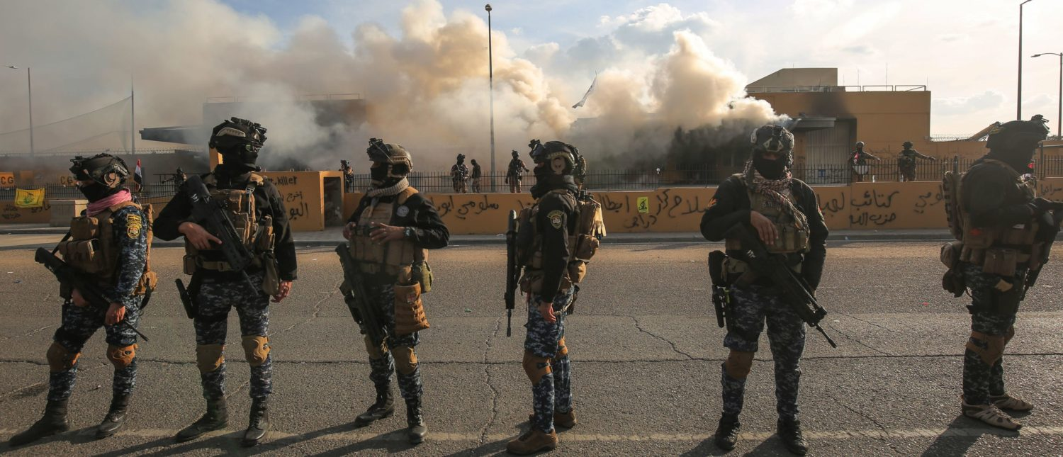 Iraqi security forces are deployed in front of the US embassy in the capital Baghdad, after an order from the Hashed al-Shaabi paramilitary force to supporters to leave the compound on January 1, 2020. (AHMAD AL-RUBAYE/AFP via Getty Images)