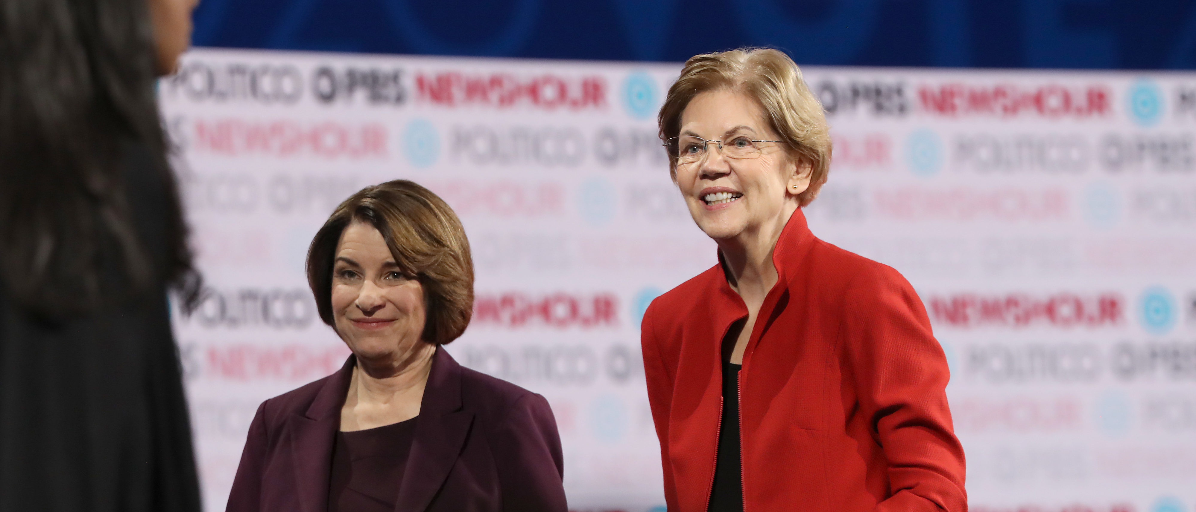 Democratic presidential candidate Sen. Elizabeth Warren (D-MA) (R) and Sen. Amy Klobuchar (D-MN)) walk on the stage after the Democratic presidential primary debate at Loyola Marymount University on December 19, 2019 in Los Angeles, California. (Justin Sullivan/Getty Images)