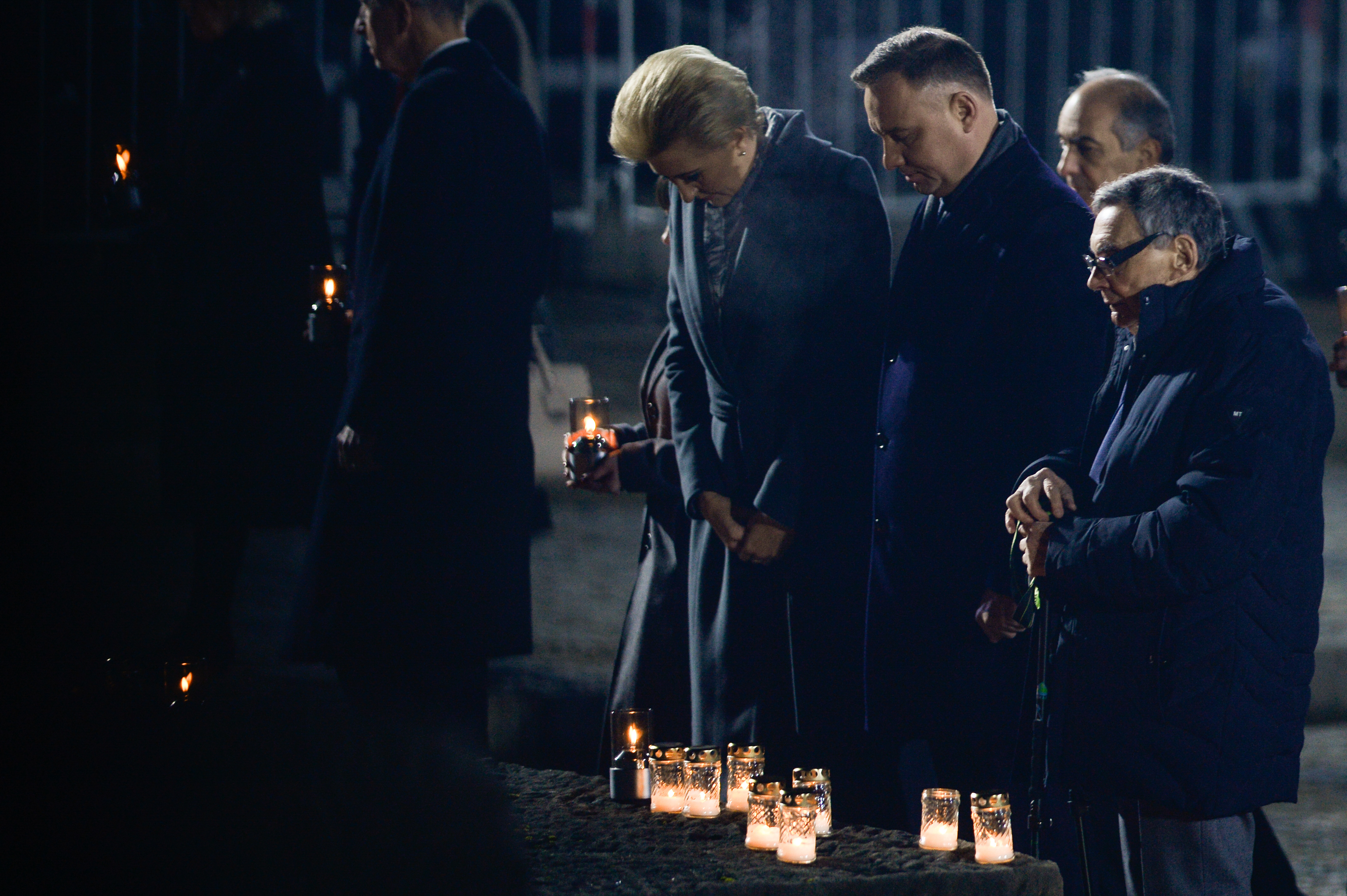 OSWIECIM, POLAND - JANUARY 27: Polish President Andrzej Duda, Polish First Lady Agata Kornhauser-Duda and Holocaust survivor Marian Turski light candles at the International Monument to the Victims of Fascism in the former Nazi-German concentration and extermination camp KL Auschwitz II-Birkenau during the 75th Anniversary of Auschwitz Liberation on January 27, 2020 in Oswiecim, Poland. International leaders as well as approximately 200 survivors and their families are gathering today at Auschwitz today to commemorate the 75th anniversary of the camp's liberation. The Nazis killed an estimated one million people at the camp during the World War II occupation of Poland by Nazi Germany. (Photo by Omar Marques/Getty Images)