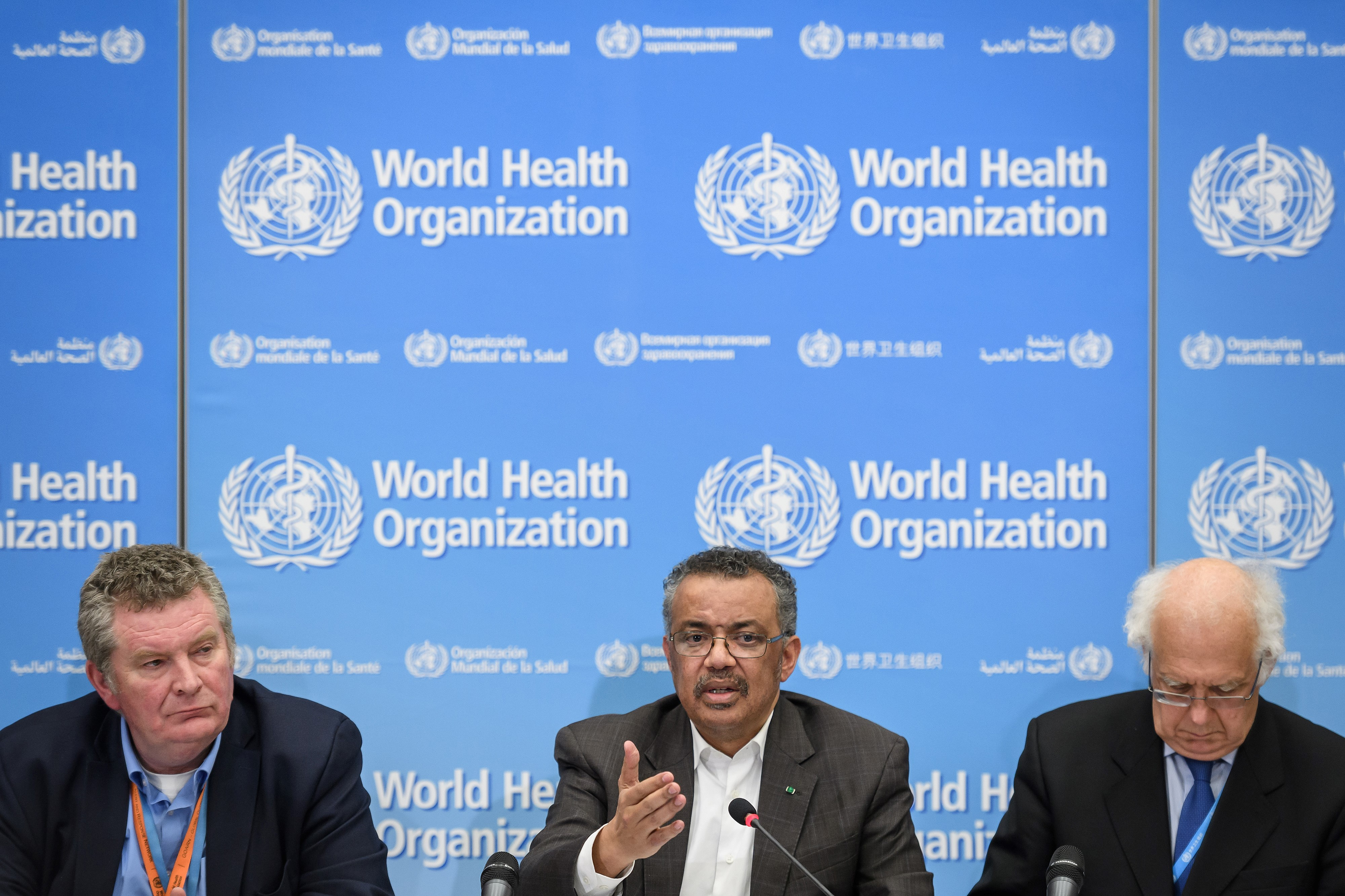 (From L) World Health Organization (WHO) Health Emergencies Programme head Michael Ryan, WHO Director-General Tedros Adhanom Ghebreyesus and WHO Emergency Committee Chair Didier Houssin speak during a press conference following a WHO Emergency committee to discuss whether the Coronavirus, the SARS-like virus, outbreak that began in China constitutes an international health emergency, on January 30, 2020 in Geneva. (FABRICE COFFRINI/AFP via Getty Images)