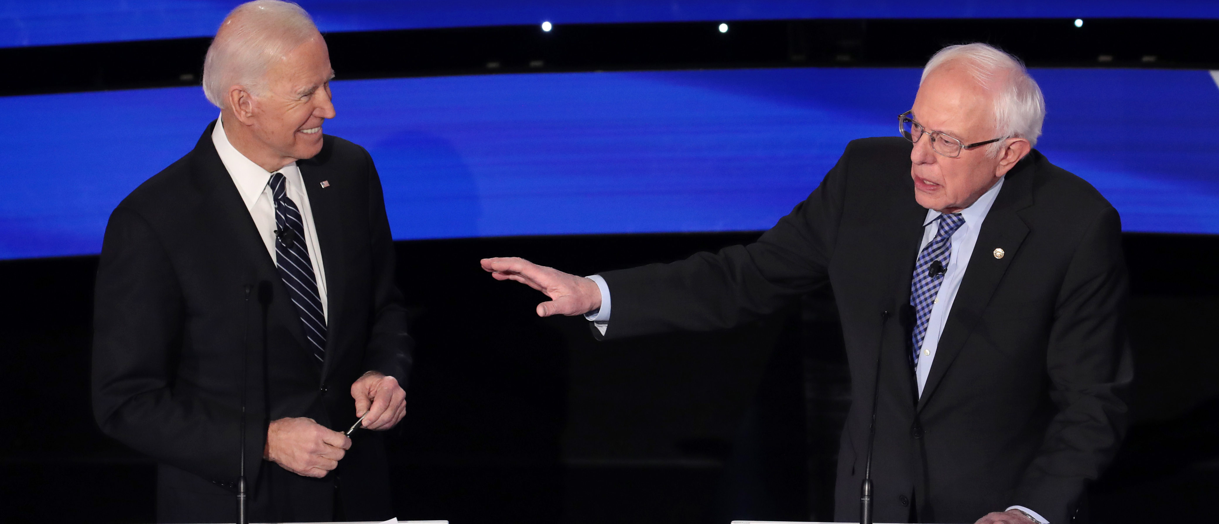 DES MOINES, IOWA - JANUARY 14: Former Vice President Joe Biden (L) reacts as Sen. Bernie Sanders (I-VT) makes a point during the Democratic presidential primary debate at Drake University on January 14, 2020 in Des Moines, Iowa. Six candidates out of the field qualified for the first Democratic presidential primary debate of 2020, hosted by CNN and the Des Moines Register. (Photo by Scott Olson/Getty Images)