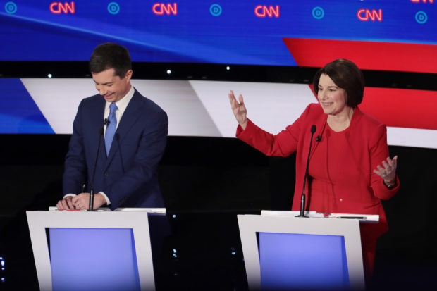 DES MOINES, IOWA - JANUARY 14: Sen. Amy Klobuchar (D-MN) makes a point as former South Bend, Indiana Mayor Pete Buttigieg reacts during the Democratic presidential primary debate at Drake University on January 14, 2020 in Des Moines, Iowa. Six candidates out of the field qualified for the first Democratic presidential primary debate of 2020, hosted by CNN and the Des Moines Register. (Photo by Scott Olson/Getty Images)