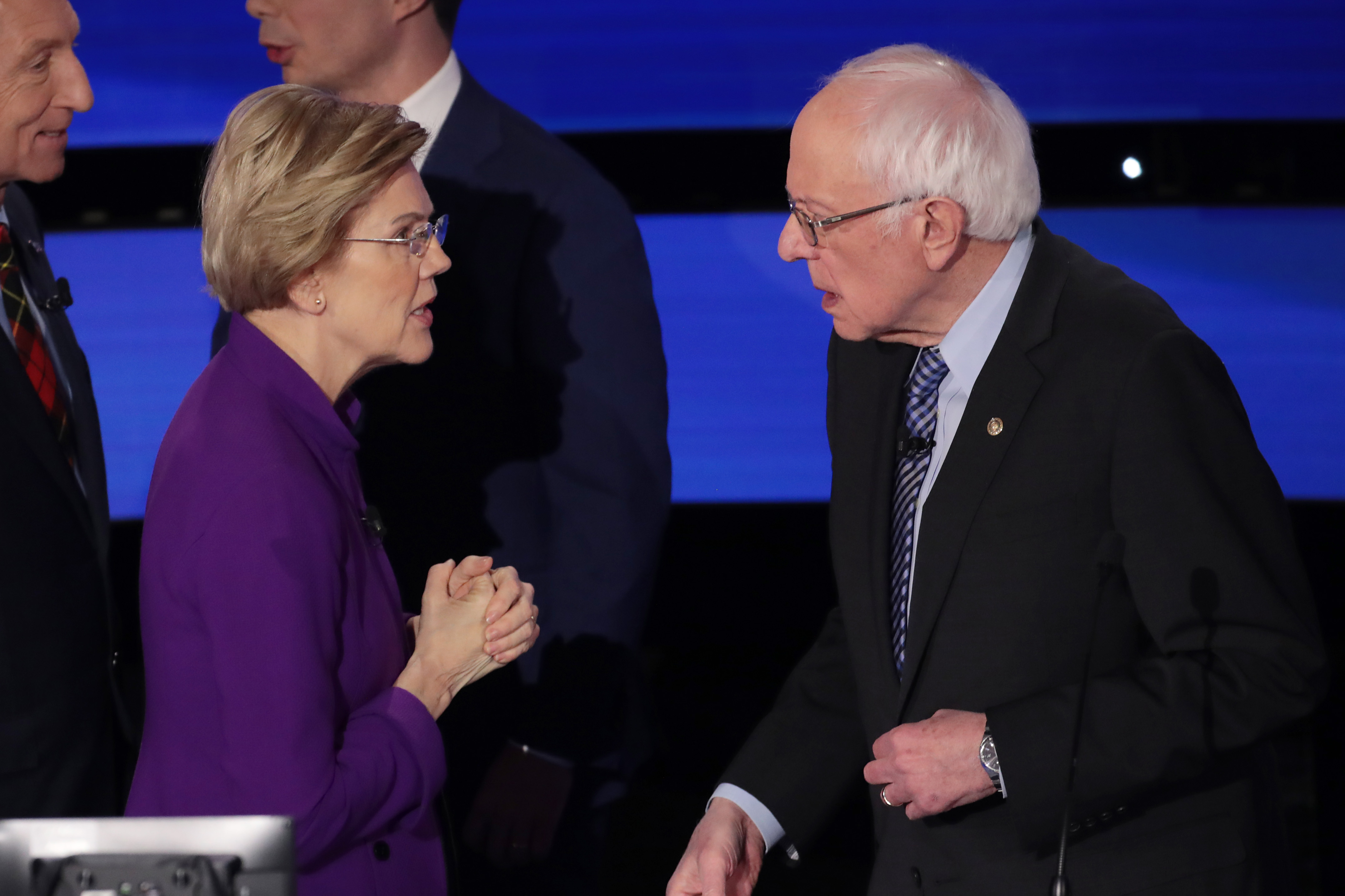 DES MOINES, IOWA - JANUARY 14: Sen. Elizabeth Warren (D-MA) and Sen. Bernie Sanders (I-VT) speak after the Democratic presidential primary debate at Drake University on January 14, 2020 in Des Moines, Iowa. Six candidates out of the field qualified for the first Democratic presidential primary debate of 2020, hosted by CNN and the Des Moines Register. (Photo by Scott Olson/Getty Images)