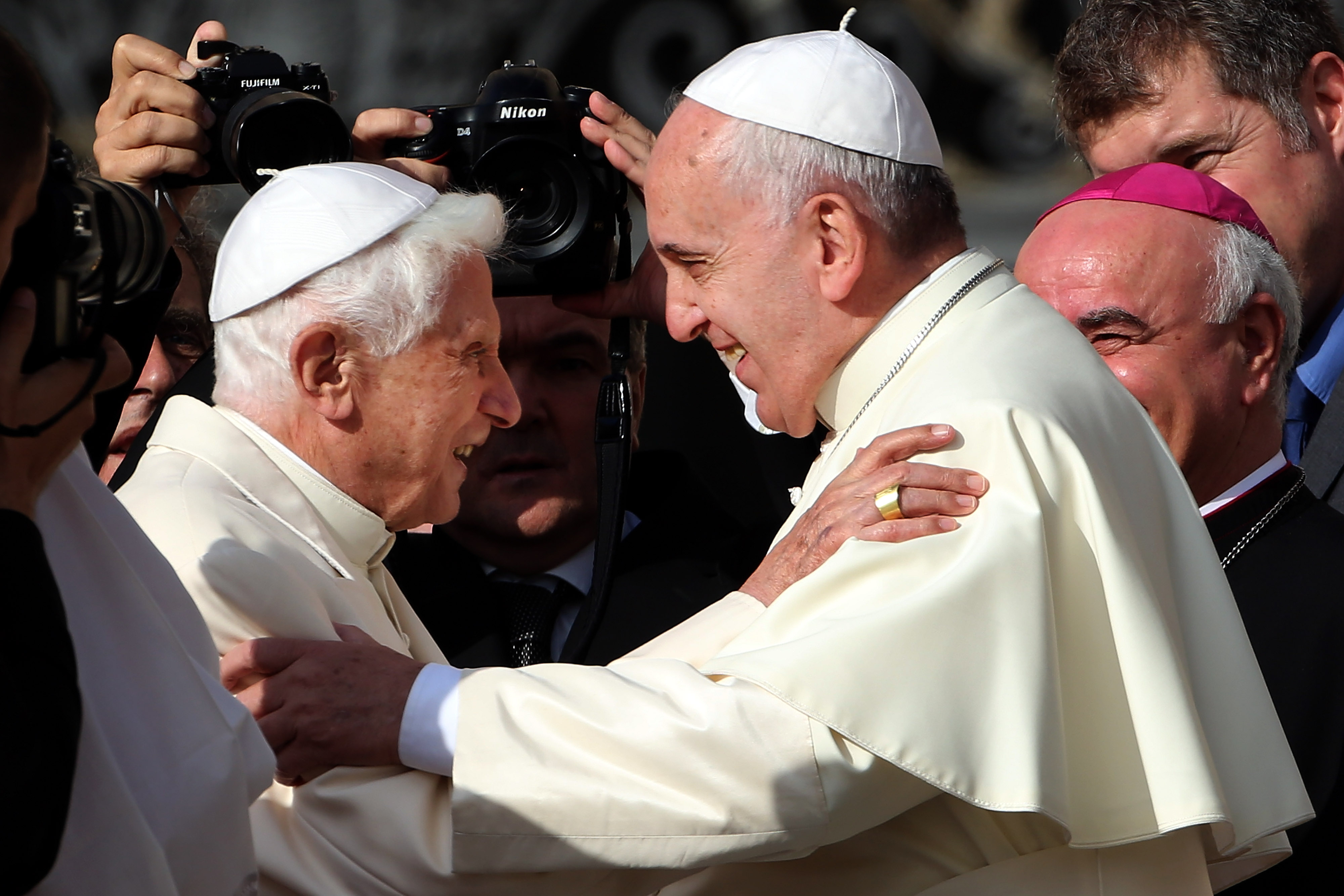 VATICAN CITY, VATICAN - SEPTEMBER 28: Pope Francis (R) greets Pope Emeritus Benedict XVI as he arrives at St. Peter's Basilica during a celebration for grandparents and the elderly on September 28, 2014 in Vatican City, Vatican. Pope Francis celebrated Mass on Sunday morning in St Peter's Square, following a special encounter with elderly persons. In his homily, the Holy Father said 'Elderly are key to health of free society'. (Photo by Franco Origlia/Getty Images)