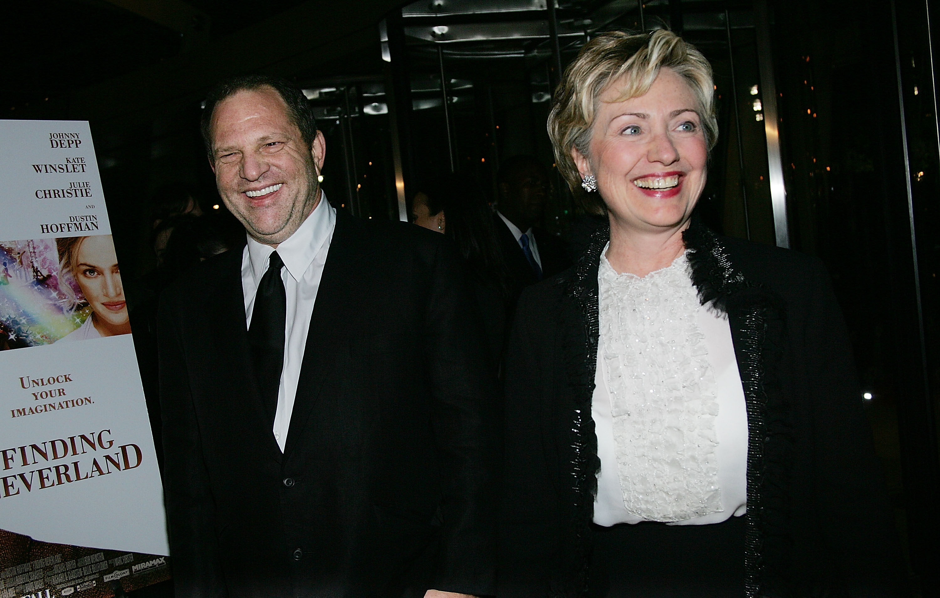 """NEW YORK - OCTOBER 25: Producer Harvey Weinstein and Senator Hillary Clinton (D-NY) attend the """"Finding Neverland"""" premiere at the Brooklyn Museum October 25, 2004 in New York City. (Photo by Evan Agostini/Getty Images)"""