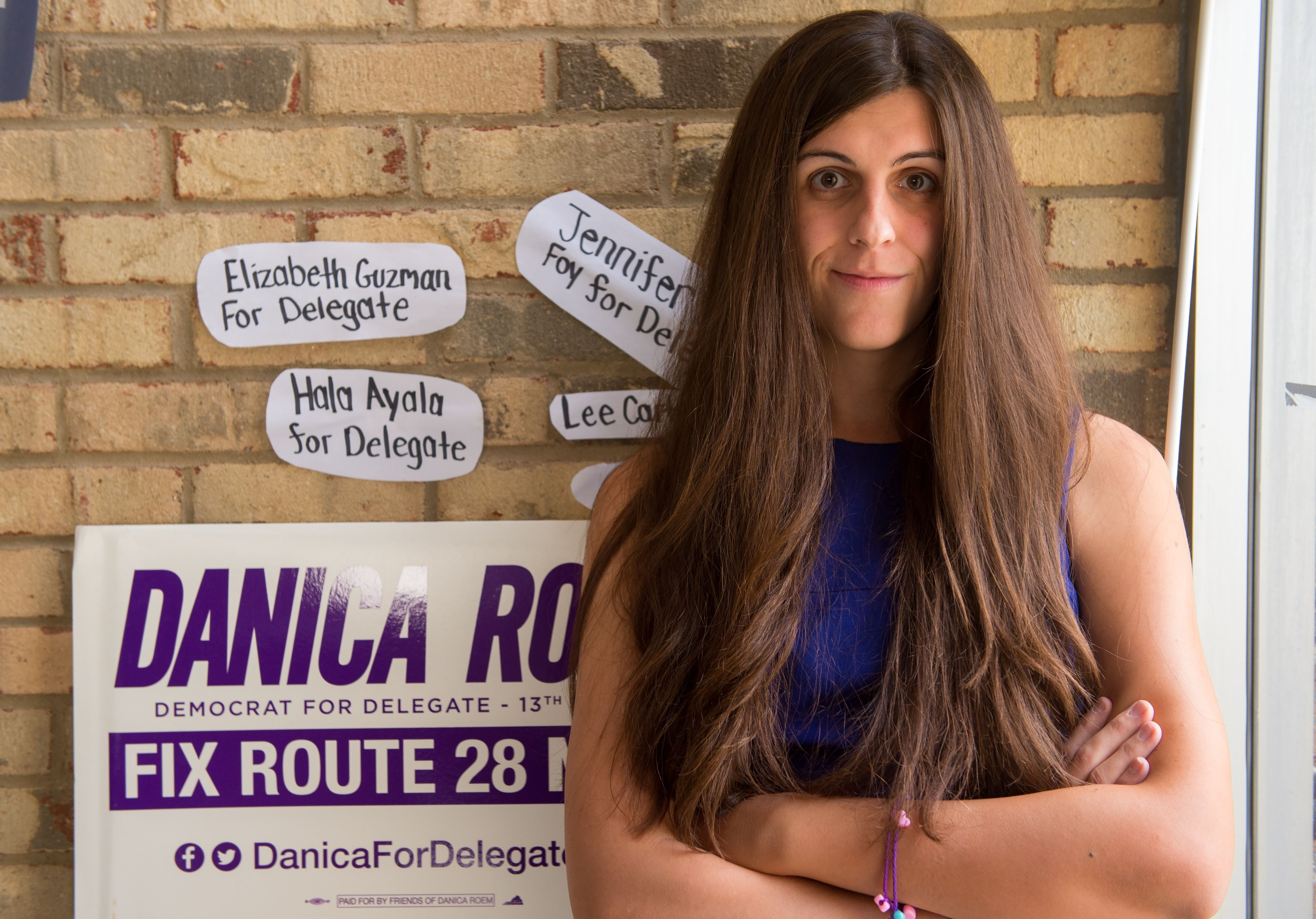 "Danica Roem, a Democrat for Delegate in Virginia's district 13, and who is transgender, sits in her campaign office on September 22, 2017, in Manassas, Virginia. - ""Look at the inside of my shoe, ok?"" replies Danica Roem when asked how many voters she has already approached in her bid to win a Virginia statehouse seat.The Democratic candidate has no time for subtleties as she races to become the first openly transgender person elected to office in this Republican US state. Whether spitting in the trashcan during a recent interview with Cosmopolitan magazine or whipping off her ballerina flat to show its worn insole to AFP, this young woman does not shy from flaunting her working-class roots. (Photo by Paul J. RICHARDS / AFP) / TO GO WITH AFP STORY -""Transgender metalhead makes historic political office bid"" (Photo credit should read PAUL J. RICHARDS/AFP via Getty Images)"