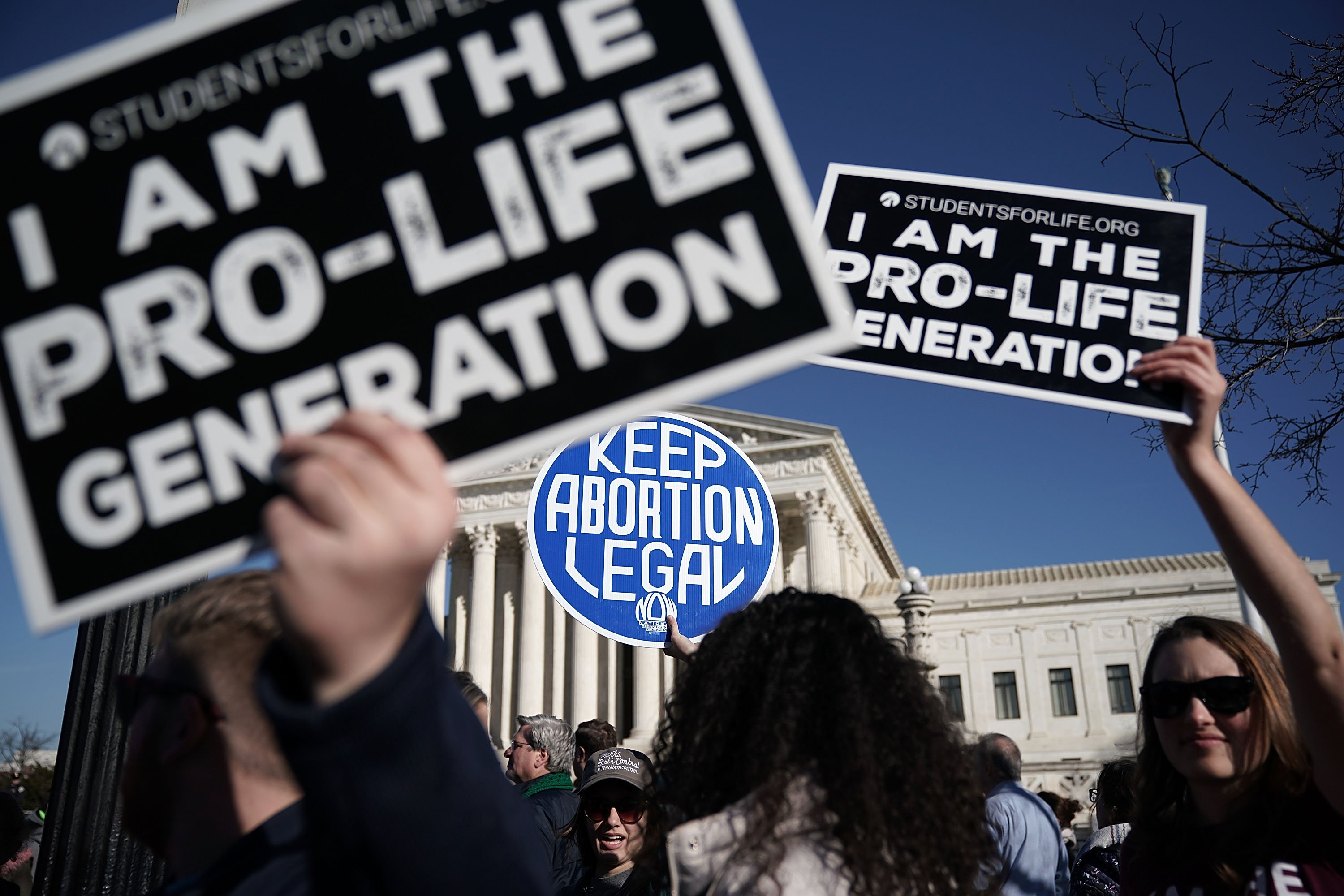 WASHINGTON, DC - JANUARY 19: Pro-life activists try to block the sign of a pro-choice activist during the 2018 March for Life January 19, 2018 in Washington, DC. Activists gathered in the nation's capital for the annual event to protest the anniversary of the Supreme Court Roe v. Wade ruling that legalized abortion in 1973. (Photo by Alex Wong/Getty Images)