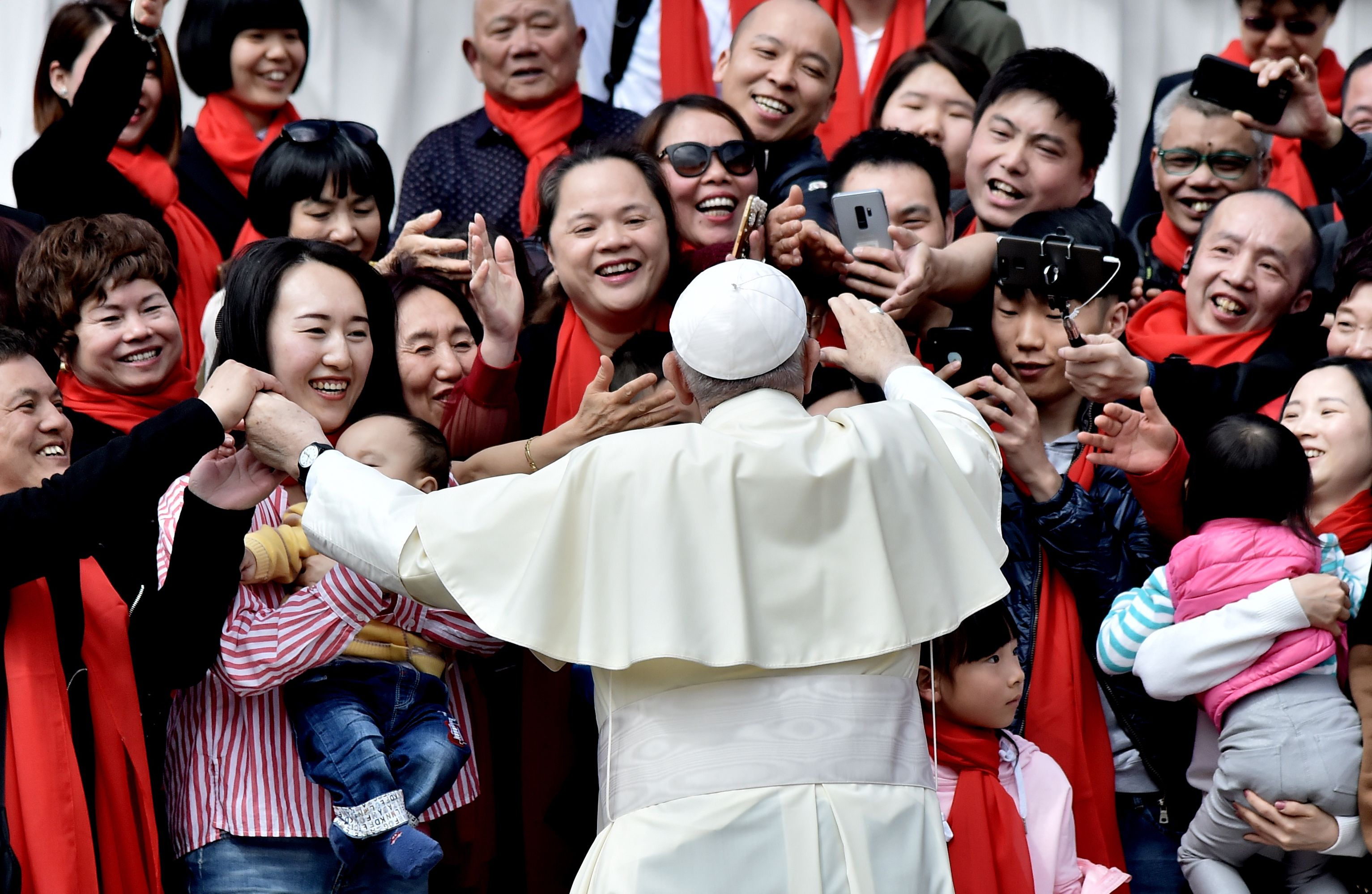 TOPSHOT - Pope Francis greets faithful from China as he arrives for his weekly general audience on April 18, 2018, on St. Peter's square in the Vatican. (Photo by TIZIANA FABI / AFP) (Photo credit should read TIZIANA FABI/AFP via Getty Images)