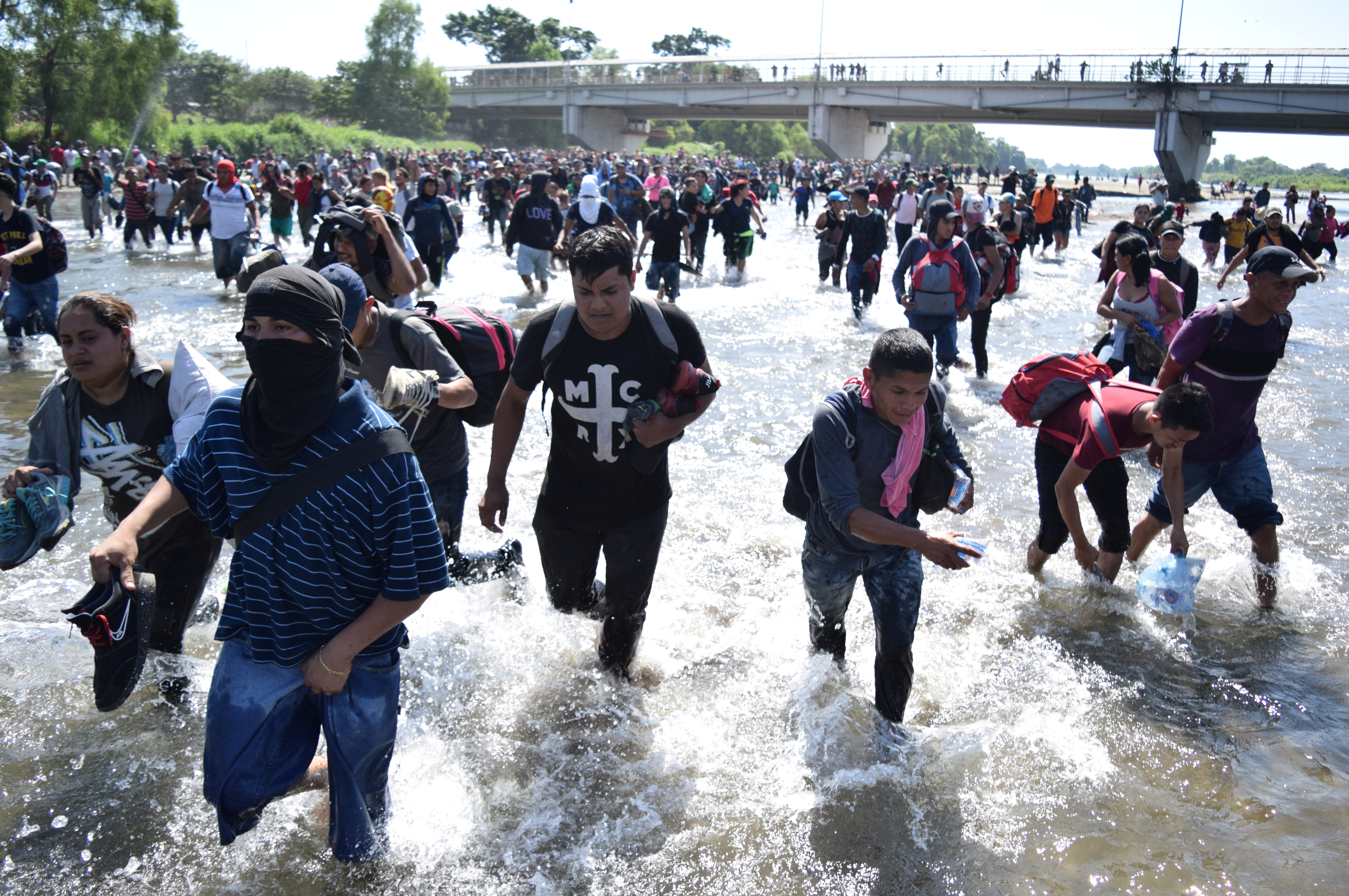 Migrants, part of a caravan travelling to the U.S, cross the Suchiate river from Tecun Uman, in Guatemala, to Ciudad Hidalgo, as seen from Ciudad Hidalgo
