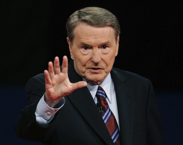 Moderator Jim Lehrer waves prior to the first U.S. Presidential Debate in Oxford, Mississippi, September 26, 2008. REUTERS/Jim Bourg