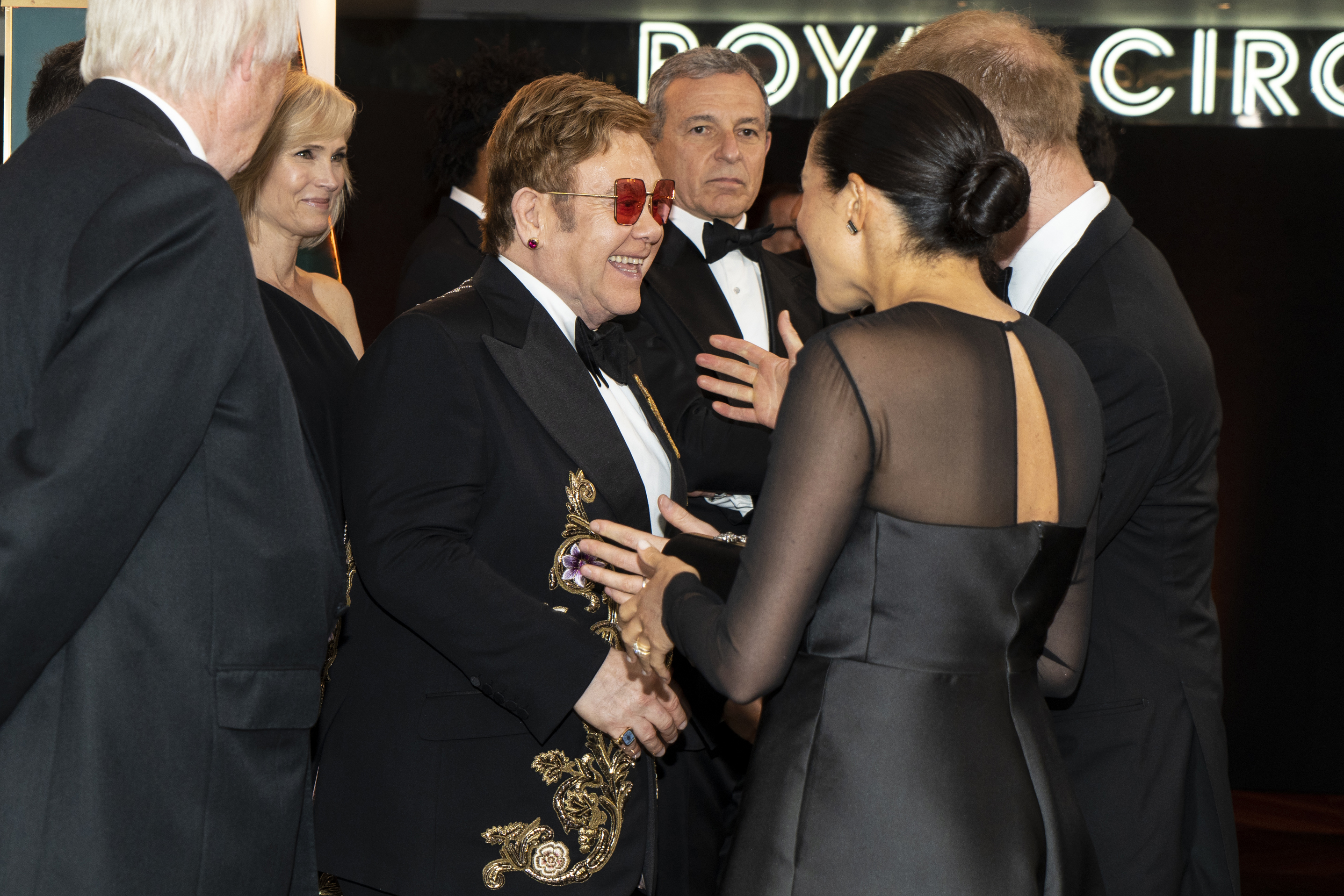Britain's Prince Harry, Duke of Sussex (R) and Britain's Meghan, Duchess of Sussex (2nd R) chat with British singer-songwriter Elton John (C) as they arrive to attend the European premiere of the film The Lion King in London on July 14, 2019. (Photo credit NIKLAS HALLE'N/AFP via Getty Images)