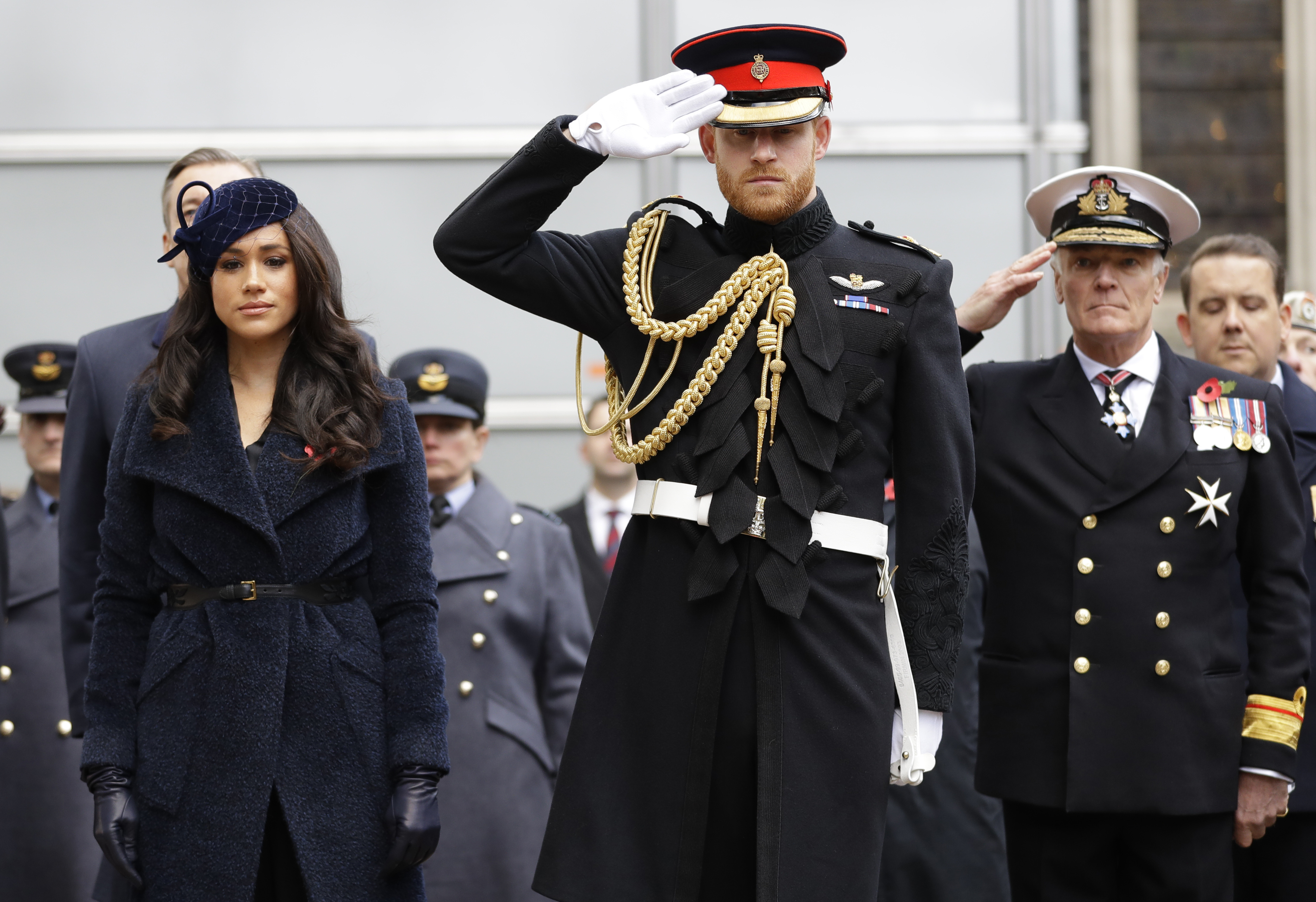 Britain's Prince Harry, Duke of Sussex and his wife Meghan, Duchess of Sussex pay their respects after laying a Cross of Remembrance in front of wooden crosses from the Graves of Unknown British Soldiers from the First and Second World Wars, during their visit to the Field of Remembrance at Westminster Abbey in central London on November 7, 2019. - The Field of Remembrance is organised by The Poppy Factory, and has been held in the grounds of Westminster Abbey since November 1928, when only two Remembrance Tribute Crosses were planted. In the run-up to Armistice Day, many Britons wear a paper red poppy -- symbolising the poppies which grew on French and Belgian battlefields during World War I -- in their lapels. (Photo by KIRSTY WIGGLESWORTH/POOL/AFP via Getty Images)