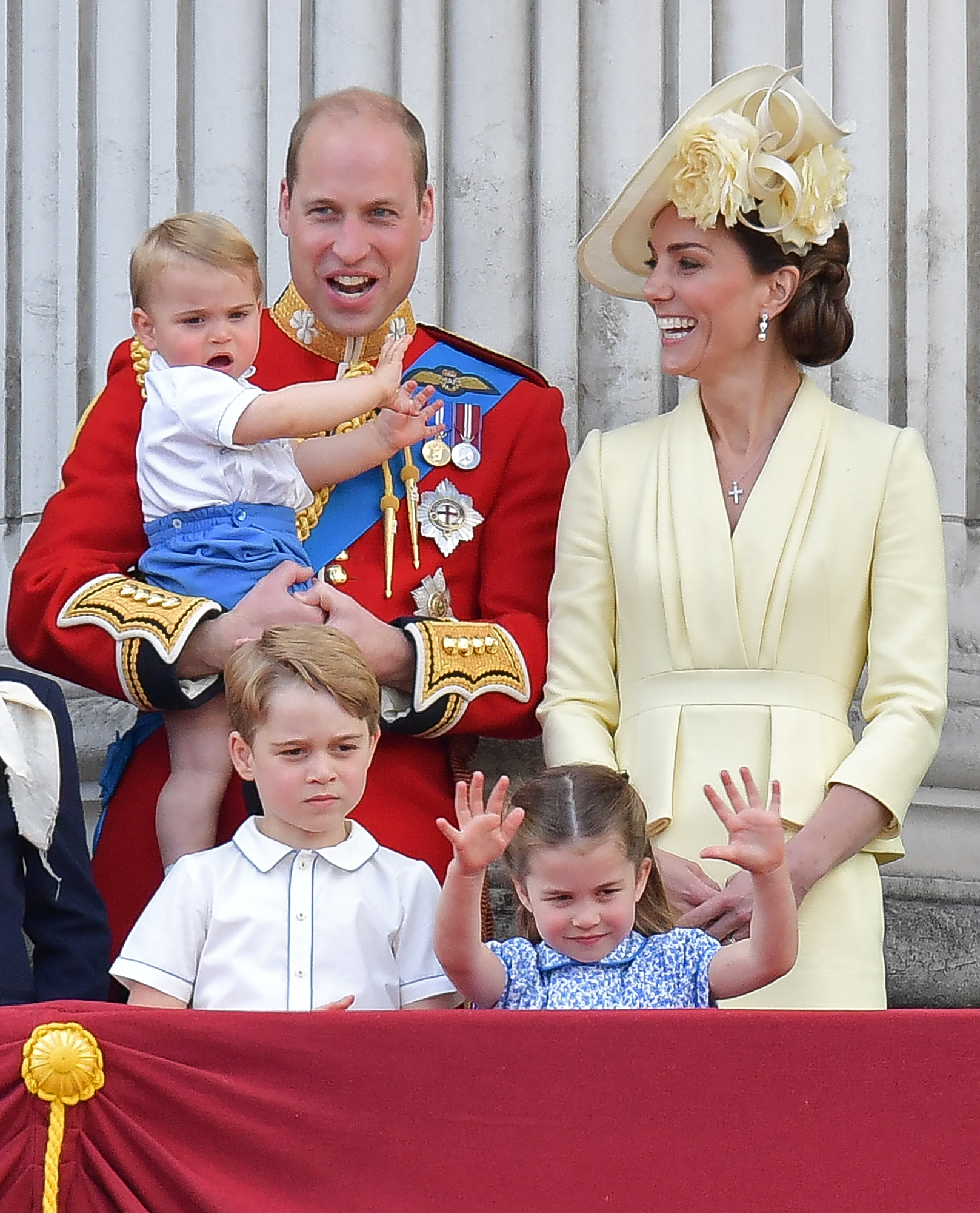 Britain's Prince William, Duke of Cambridge holding Prince Louis, Prince George, Princess Charlotte and Britain's Catherine, Duchess of Cambridge stand with other members of the Royal Family on the balcony of Buckingham Palace to watch a fly-past of aircraft by the Royal Air Force, in London on June 8, 2019. - The ceremony of Trooping the Colour is believed to have first been performed during the reign of King Charles II. Since 1748, the Trooping of the Colour has marked the official birthday of the British Sovereign. Over 1400 parading soldiers, almost 300 horses and 400 musicians take part in the event. (Photo credit DANIEL LEAL-OLIVAS/AFP via Getty Images)