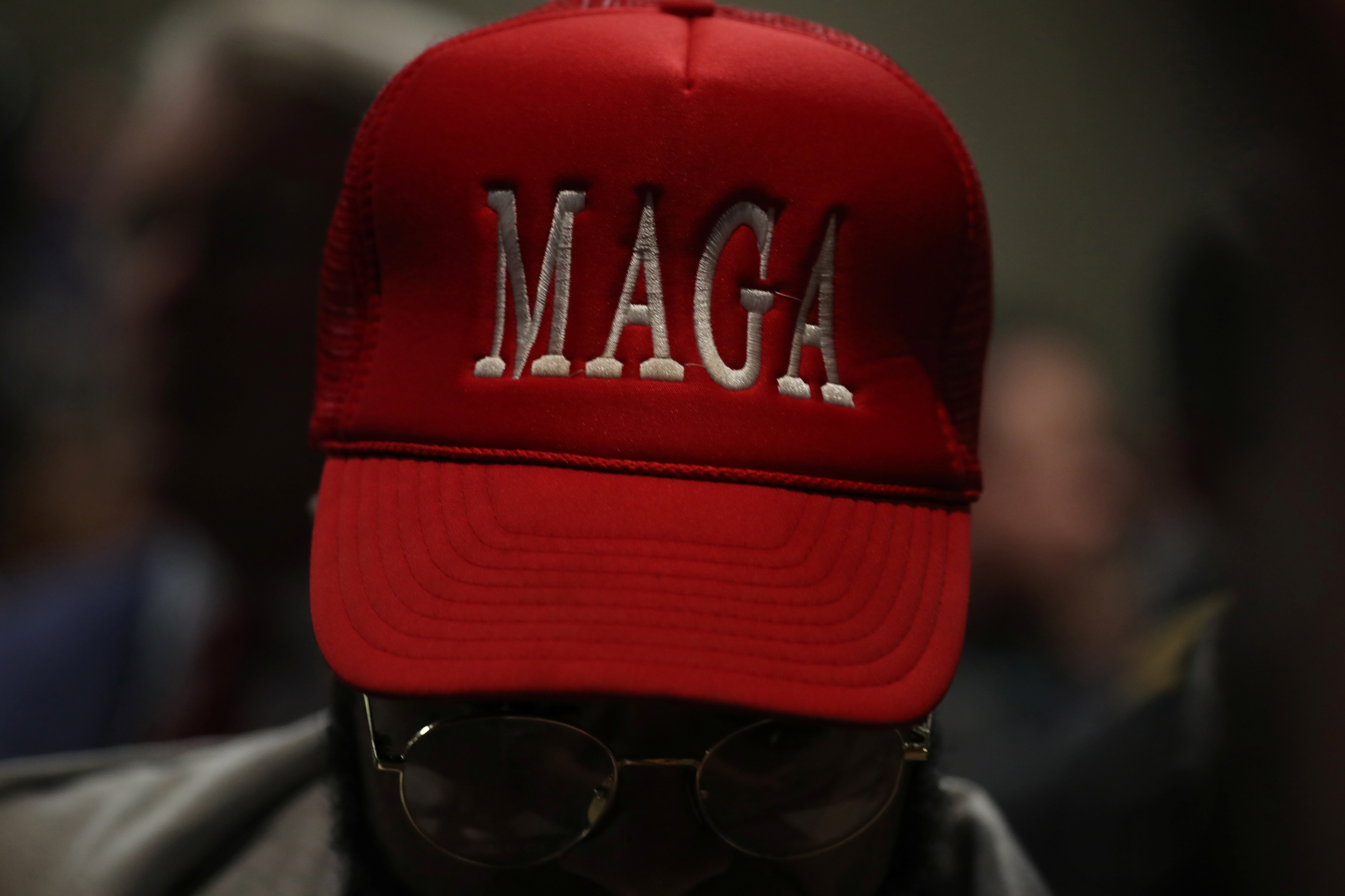 A man in a MAGA hat listens as U.S. President Donald Trump holds a rally with African-American supporters in Atlanta, Georgia, U.S. November 8, 2019. (REUTERS/Jonathan Ernst)