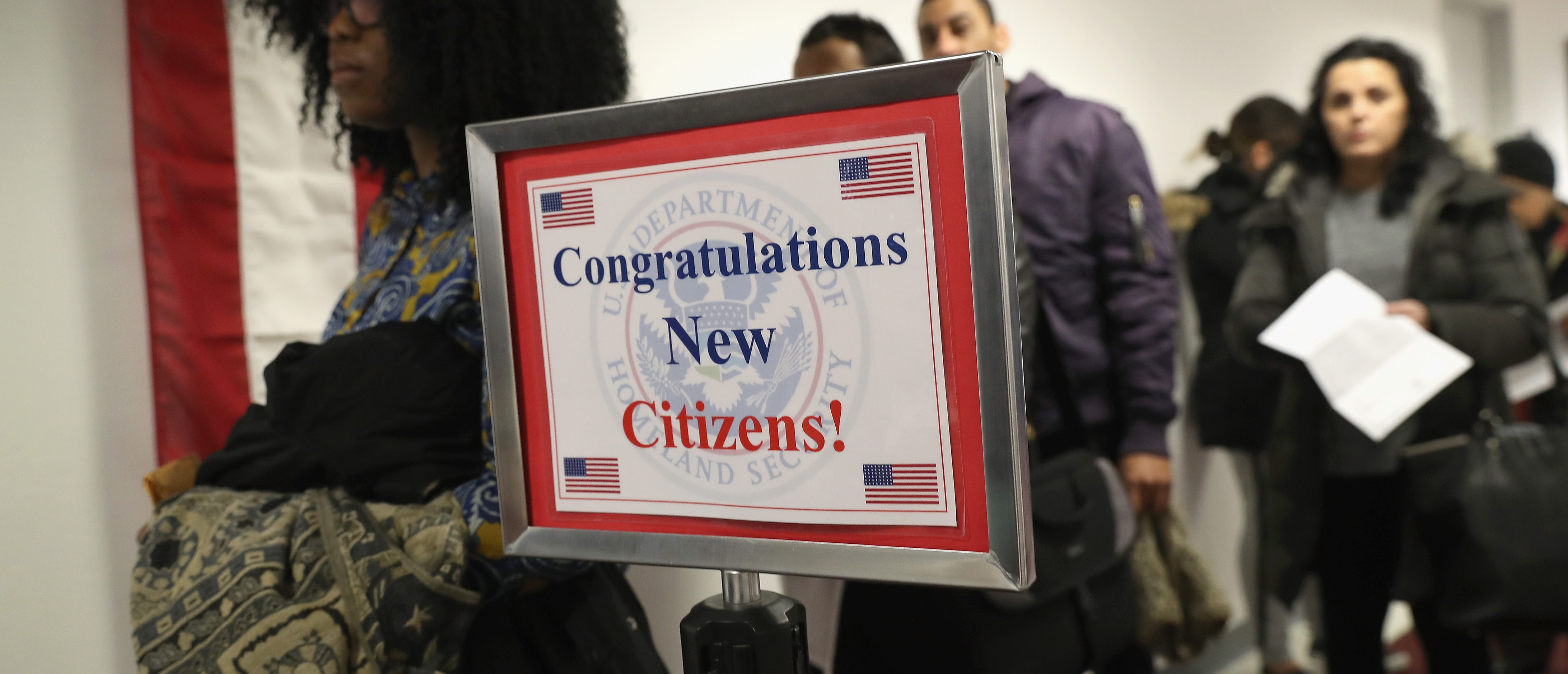 Immigrants wait in line to become U.S. citizens at a naturalization ceremony on Feb. 2, 2018 in New York City. U.S. Citizenship and Immigration Services (USCIS) swore in 128 immigrants from 42 different countries during the ceremony at the downtown Manhattan Federal Building. (Photo by John Moore/Getty Images)