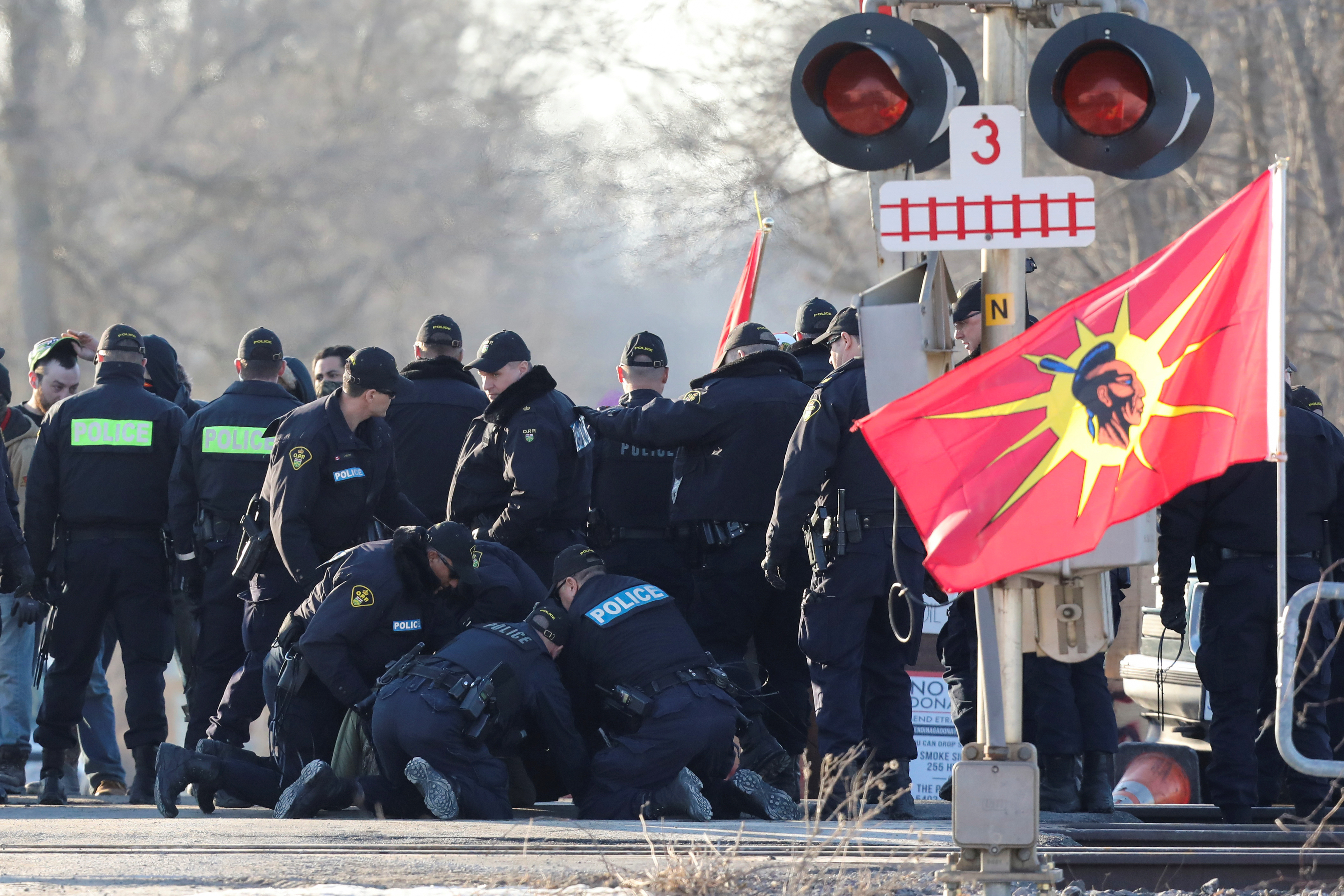 Police officers make an arrest during a raid on a Tyendinaga Mohawk Territory camp next to a railway crossing in Tyendinaga, Ontario, Canada Feb. 24, 2020. REUTERS/Chris Helgren