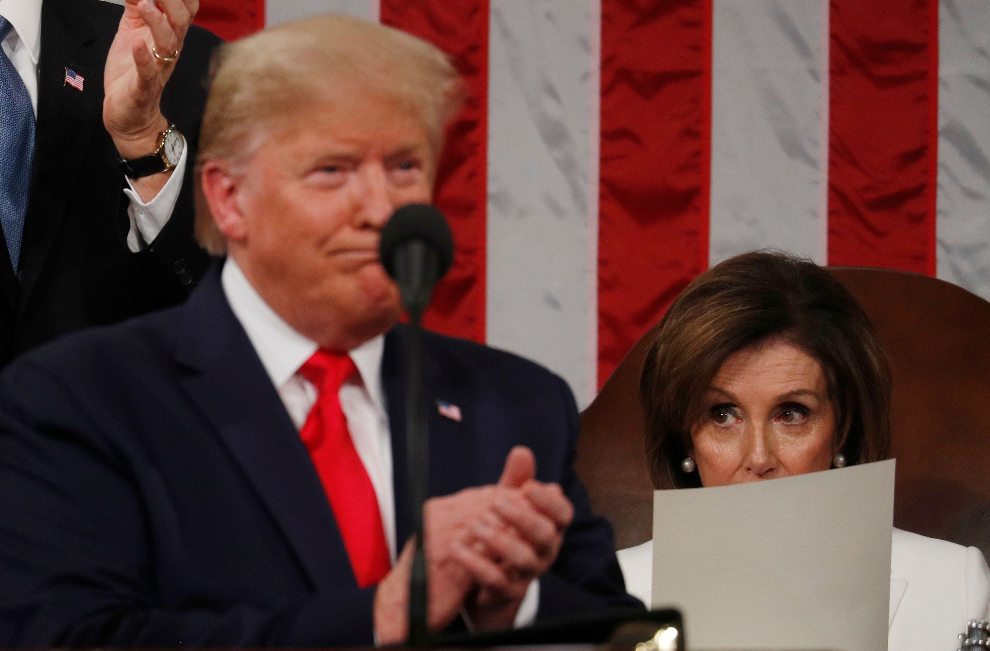 Speaker of the House Nancy Pelosi looks at a copy of the speech as U.S. President Donald Trump delivers his State of the Union address to a joint session of the U.S. Congress in the House Chamber of the U.S. Capitol in Washington, U.S. Feb. 4, 2020. REUTERS/Leah Millis/POOL